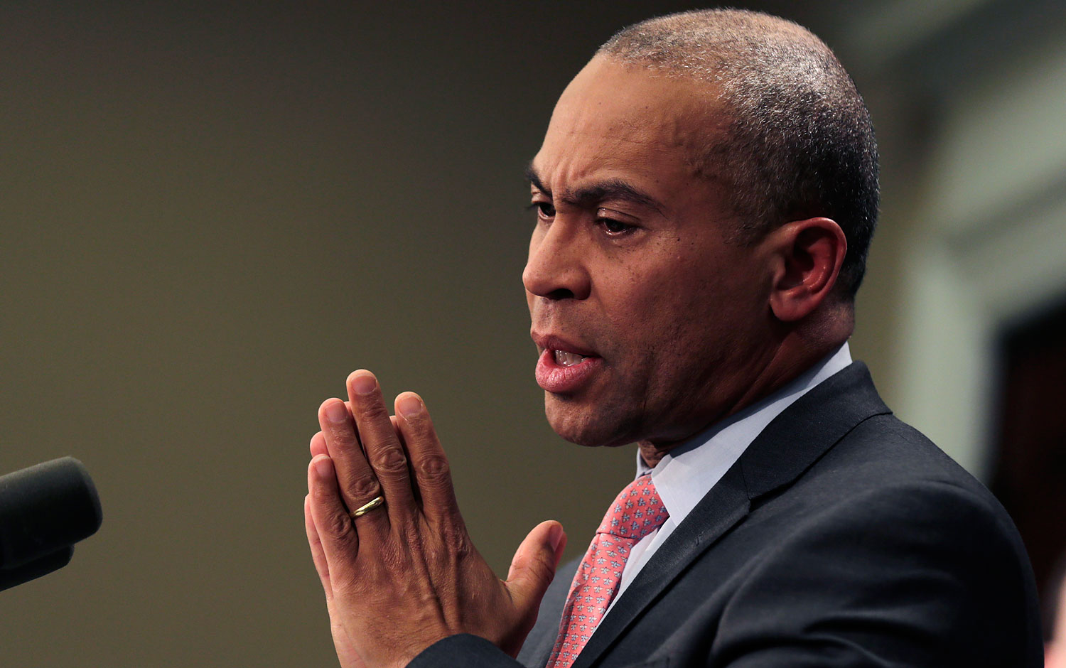 Mass. Gov. Deval Patrick gestures during a news conference at the Statehouse in Boston, Jan. 22, 2014.
