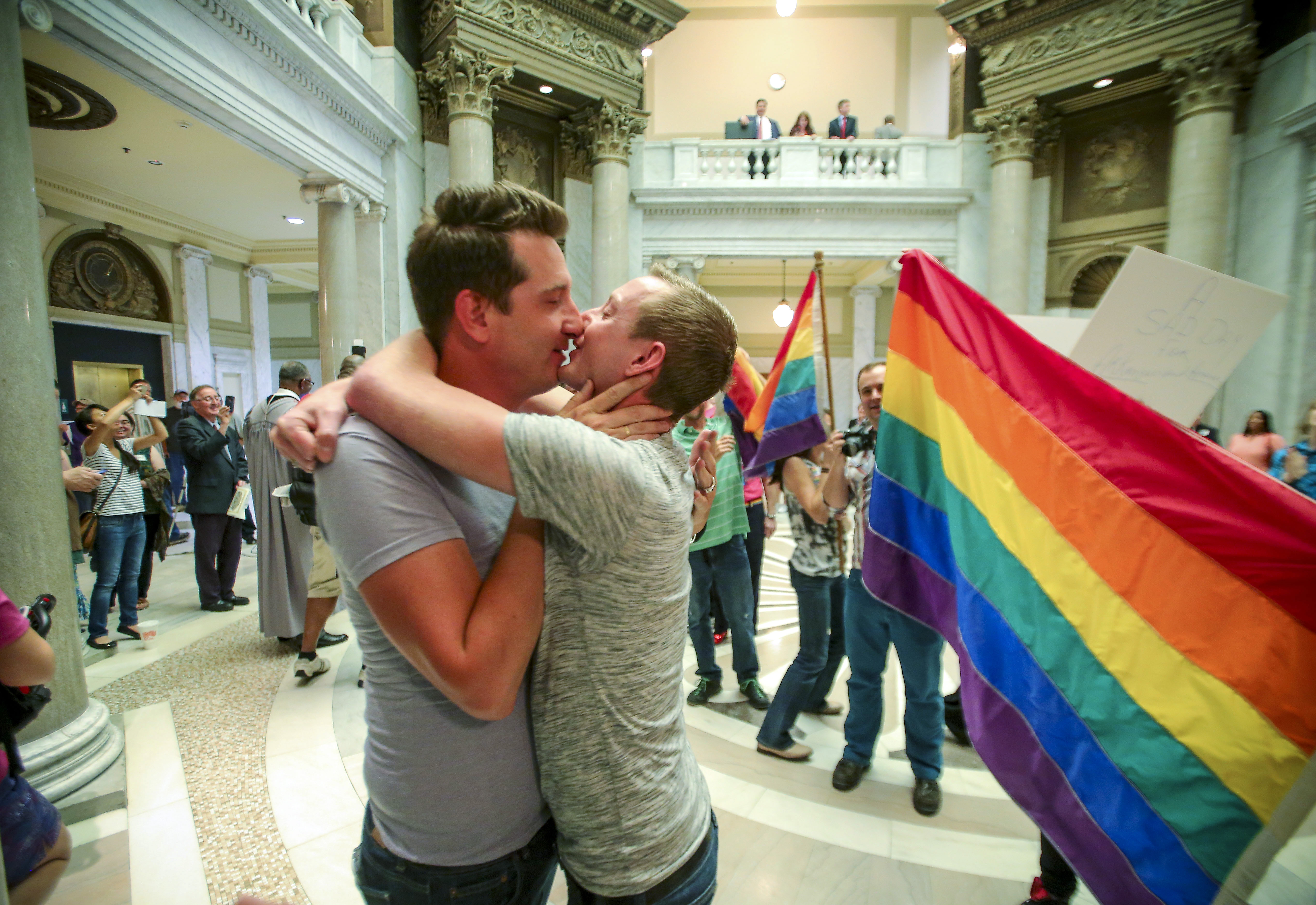 Brandon Armstrong, left, and Thomas Etheridge, right, both of Alexander, Ark. kiss and embrace after they were wed in the rotunda of the Pulaski County Courthouse in Little Rock, Ark. on May 12, 2014.