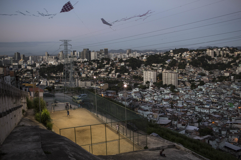 May 12, 2014. Kites fly over a soccer field at the Sao Carlos slum in Rio de Janeiro, Brazil.