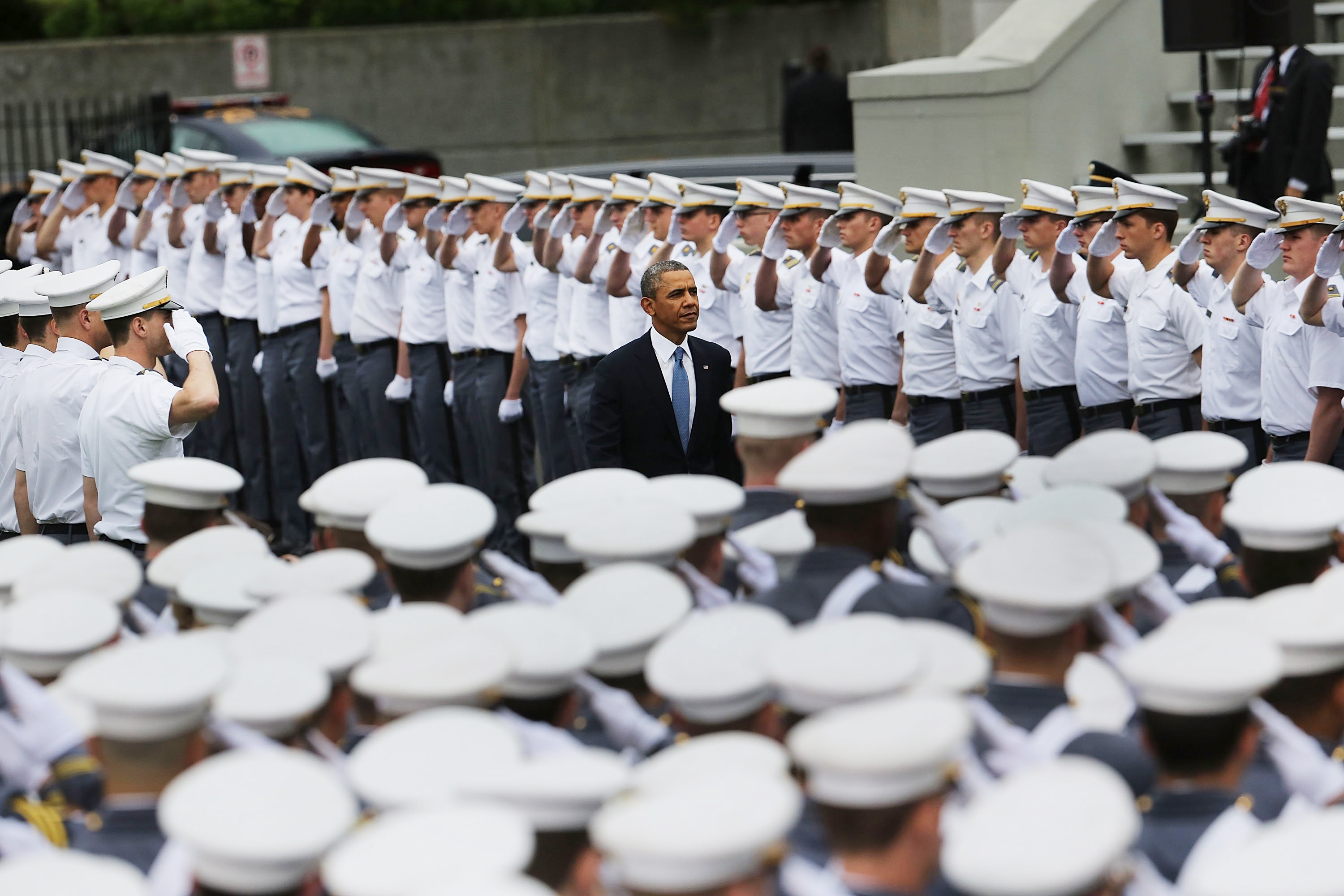 President Barack Obama enters the stadium at West Point to give the commencement address at the graduation ceremony at the U.S. Military Academy on May 28, 2014 in West Point, N.Y.