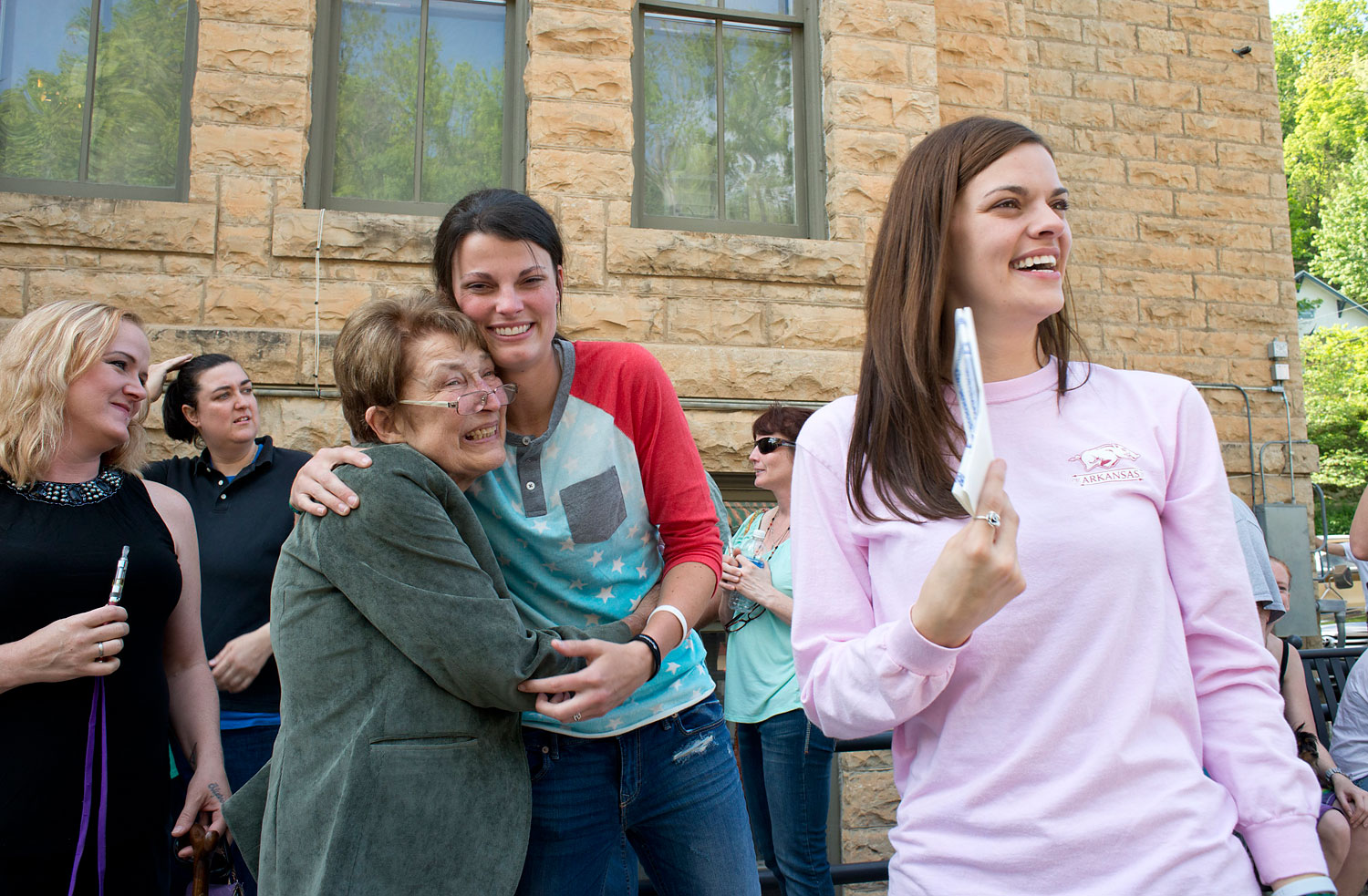 Jennifer Rambo, right, smiles as her partner Kristin Seaton, center, hugs Sheryl Maples, left, the lead attorney who filed the Wright v. the State of Arkansas lawsuit, May 10, 2014, in Eureka Springs, Ark.