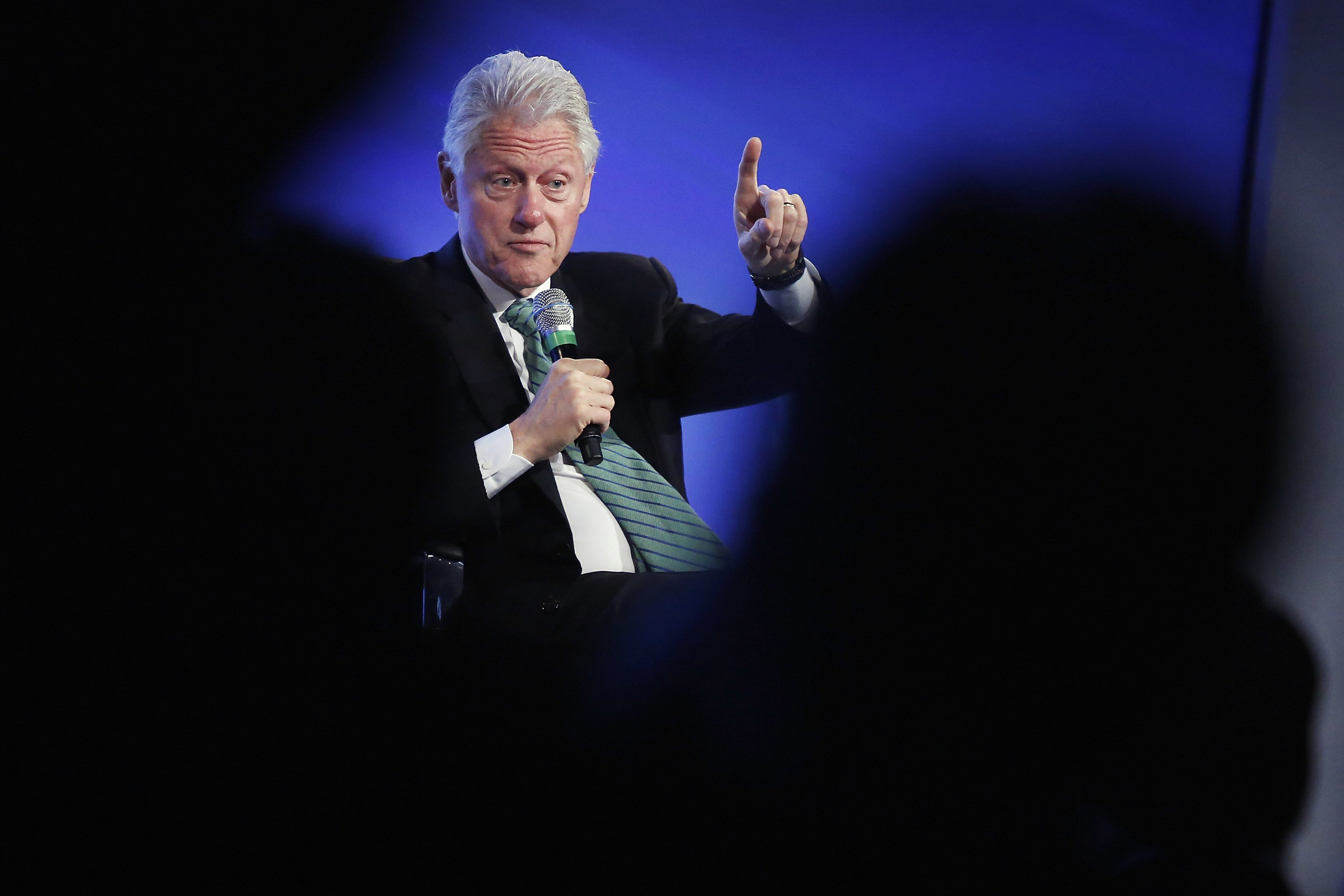 Former President Bill Clinton gestures during an onstage interview at the 2014 Peterson Foundation Fiscal Summit in Washington May 14, 2014.