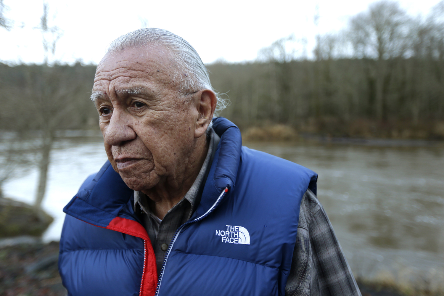 Billy Frank Jr. poses for a photo near Frank's Landing on the Nisqually River in Nisqually, Wash.