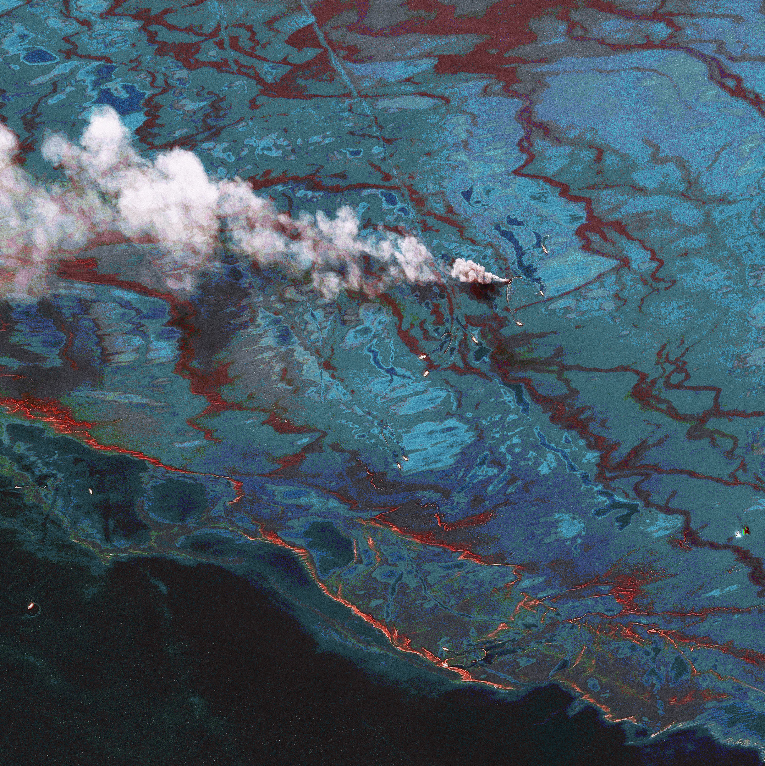 In this satellite image, vessels are seen at the site of the oil spill on June 15, 2010 in the Gulf of Mexio.