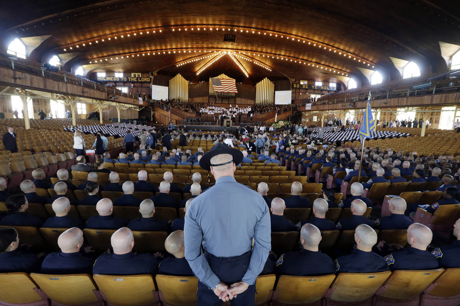 May 20, 2014. Police recruits from departments around New Jersey sit in the Ocean Grove Auditorium for the annual statewide law enforcement memorial service to remember those who lost their lives in the line of duty, in Neptune Township, N.J.