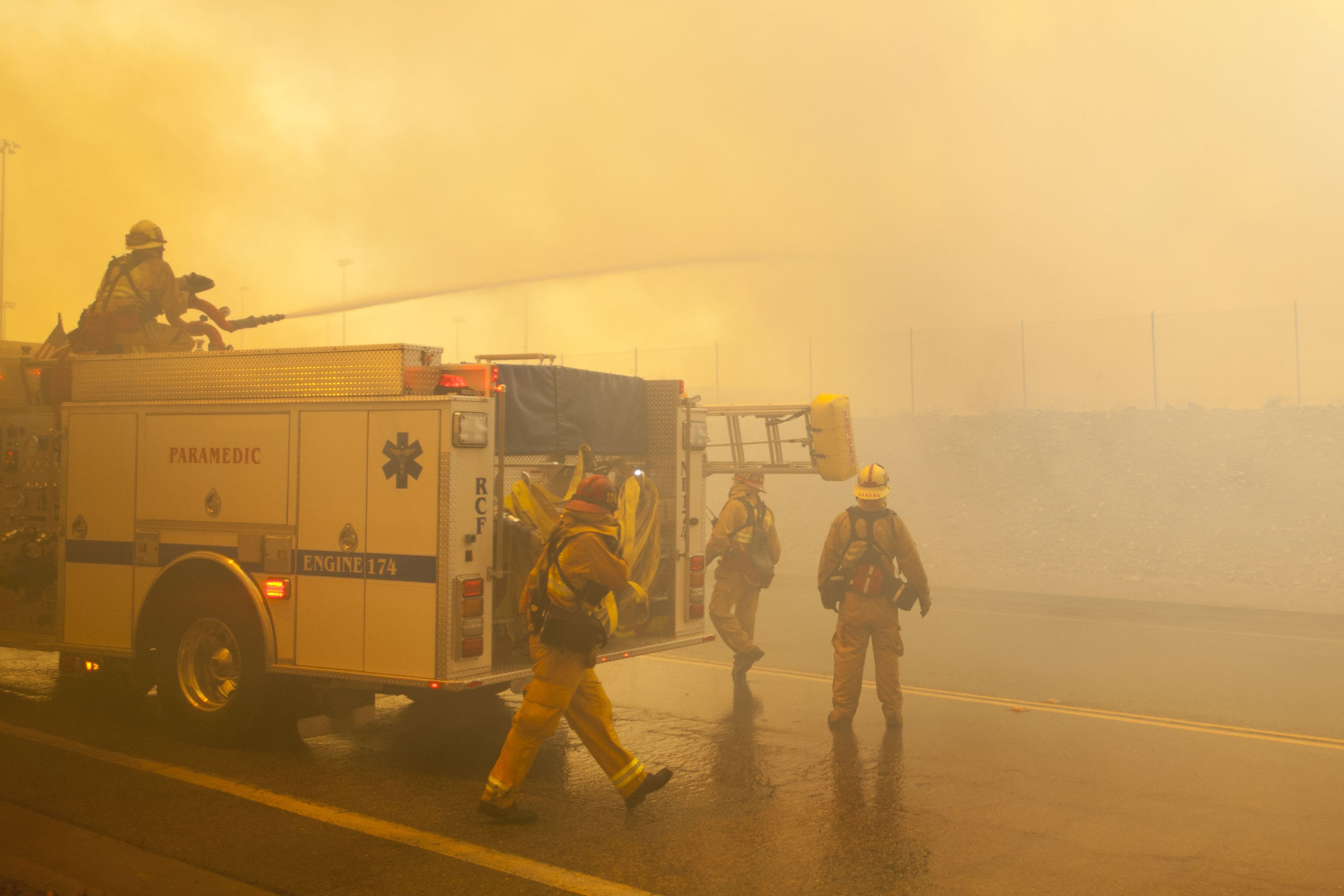A fire crew uses their deck gun to cut down an aggressive branch of the Etiwanda Fire in Rancho Cucamonga, Calif., on April 30, 2014.