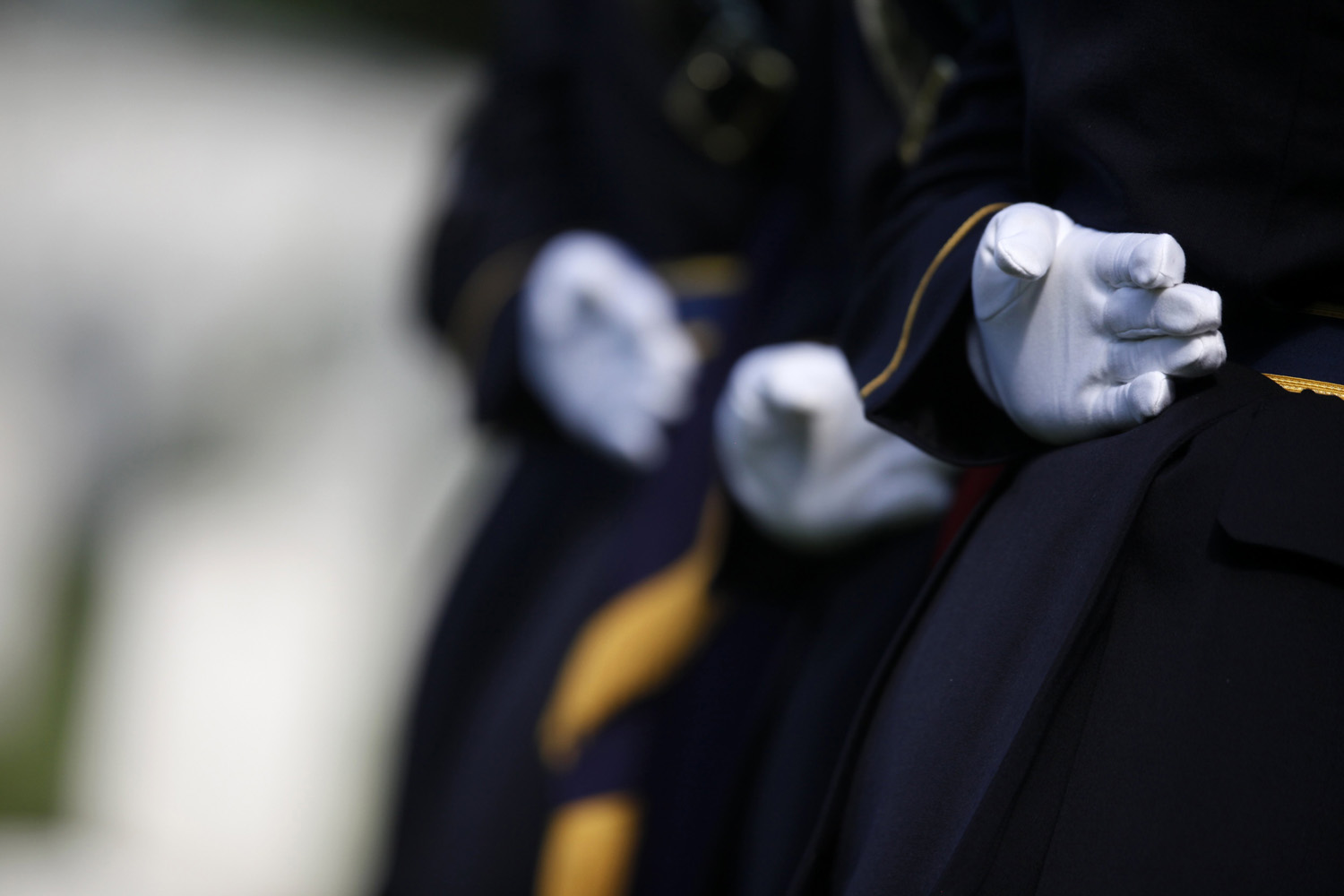 May 13, 2014. U.S. Army honor guard members stand at the gravesite of Army Pvt. William Christman, who was the first military burial at the cemetery, marking the beginning of commemorations of the 150th anniversary of Arlington National Cemetery in Arlington, Va.