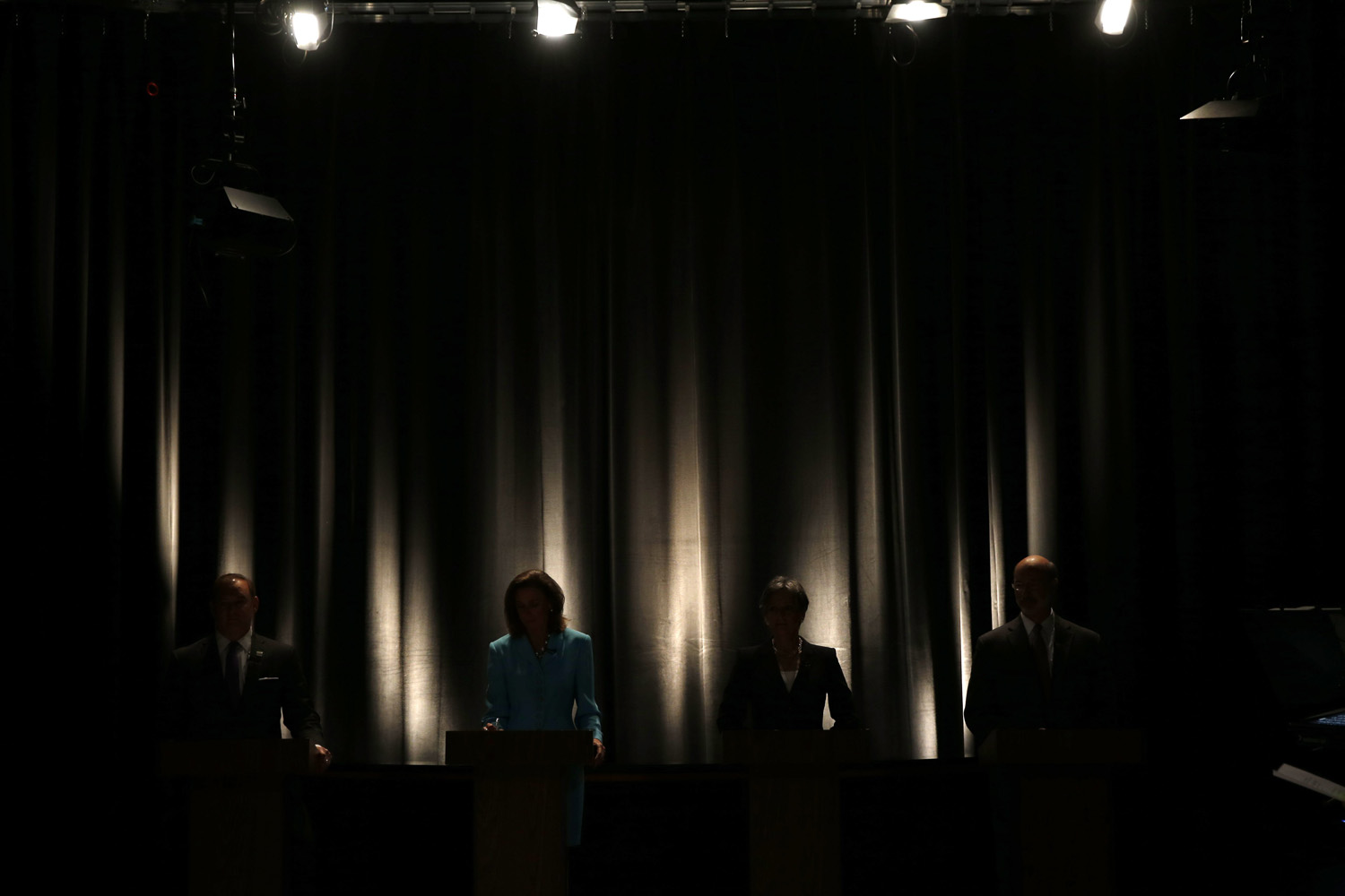 May 8, 2014, State treasurer Rob McCord, from left, former state environmental protection secretary Katie McGinty, U.S. Rep. Allyson Schwartz and businessman Tom Wolf wait for the start of the  Pennsylvania Democratic Gubernatorial Primary Debate, in Philadelphia.