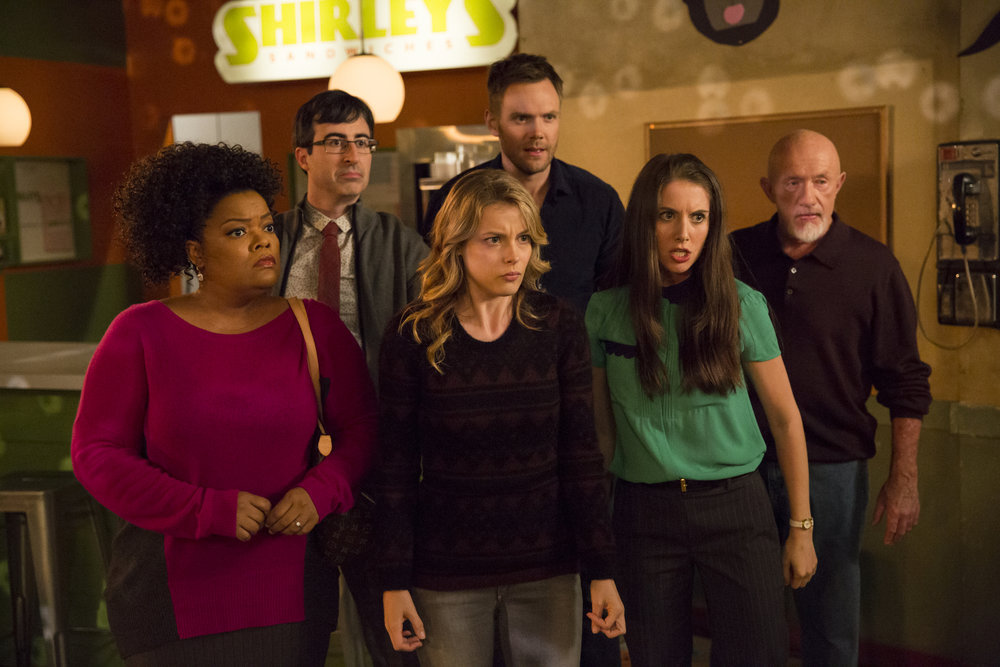 (Left to right) Yvette Nicole Brown as Shirley, John Oliver as Professor Ian Duncan, Gillian Jacobs as Britta, Joel McHale as Jeff, Alison Brie as Annie, Jonathan Banks as Professor Buzz Hickey in Community Season 5.