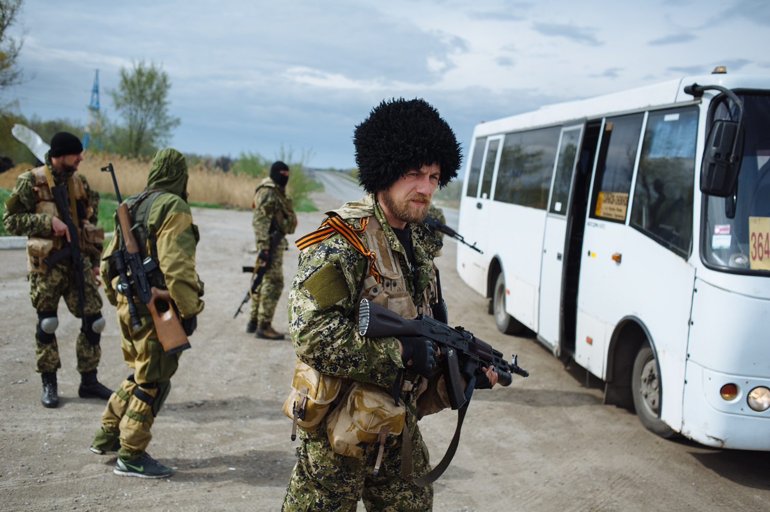 The Russian paramilitary group known as the Wolves' Hundred, with their commander Evgeny Ponomaryov in the foreground, block the road near the checkpoint not far from Slavyansk, in eastern Ukraine, April 20, 2014