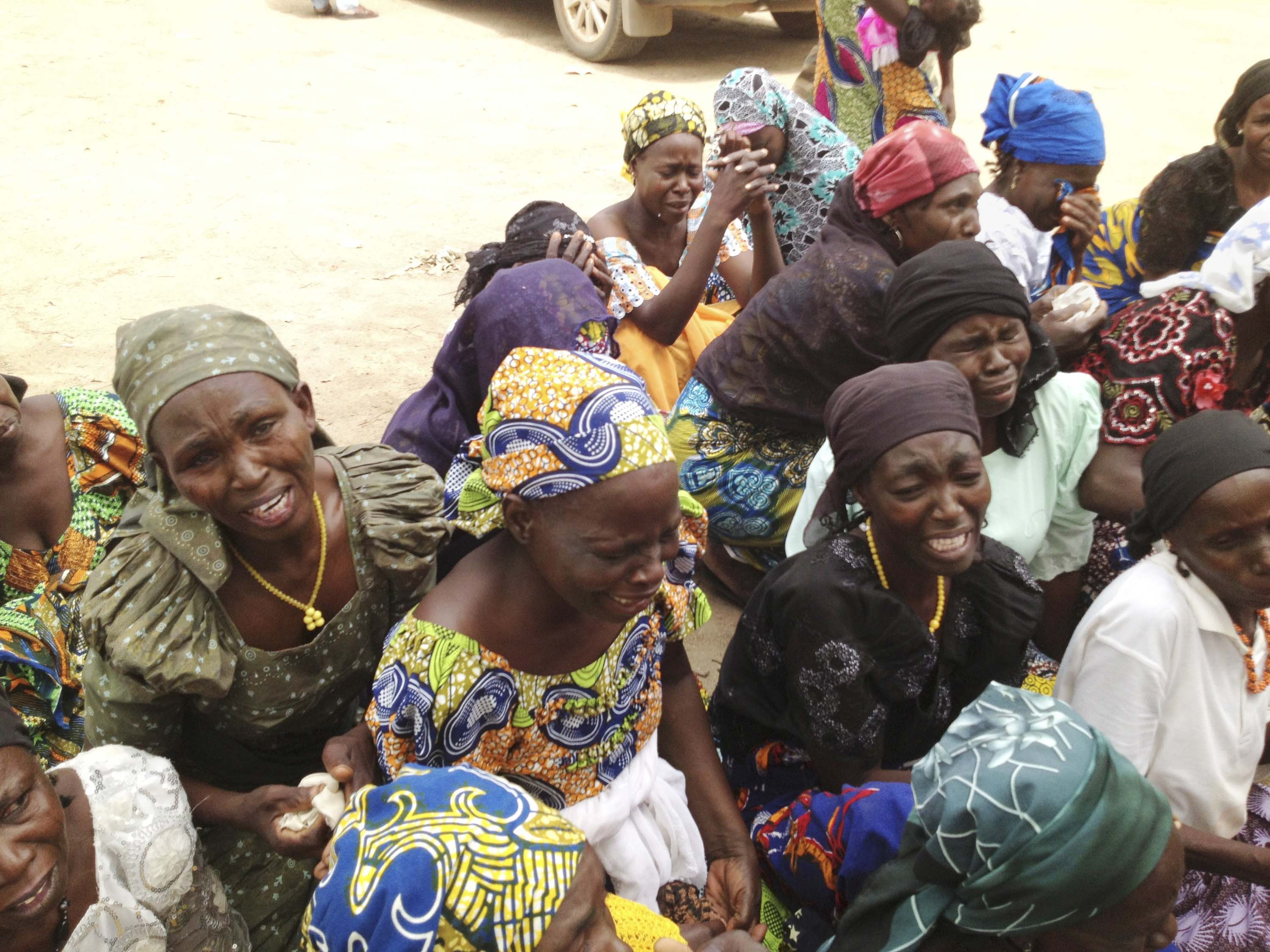 Anguish and heartache Mothers weep at the site of their daughters' burned school in Chibok, Nigeria.