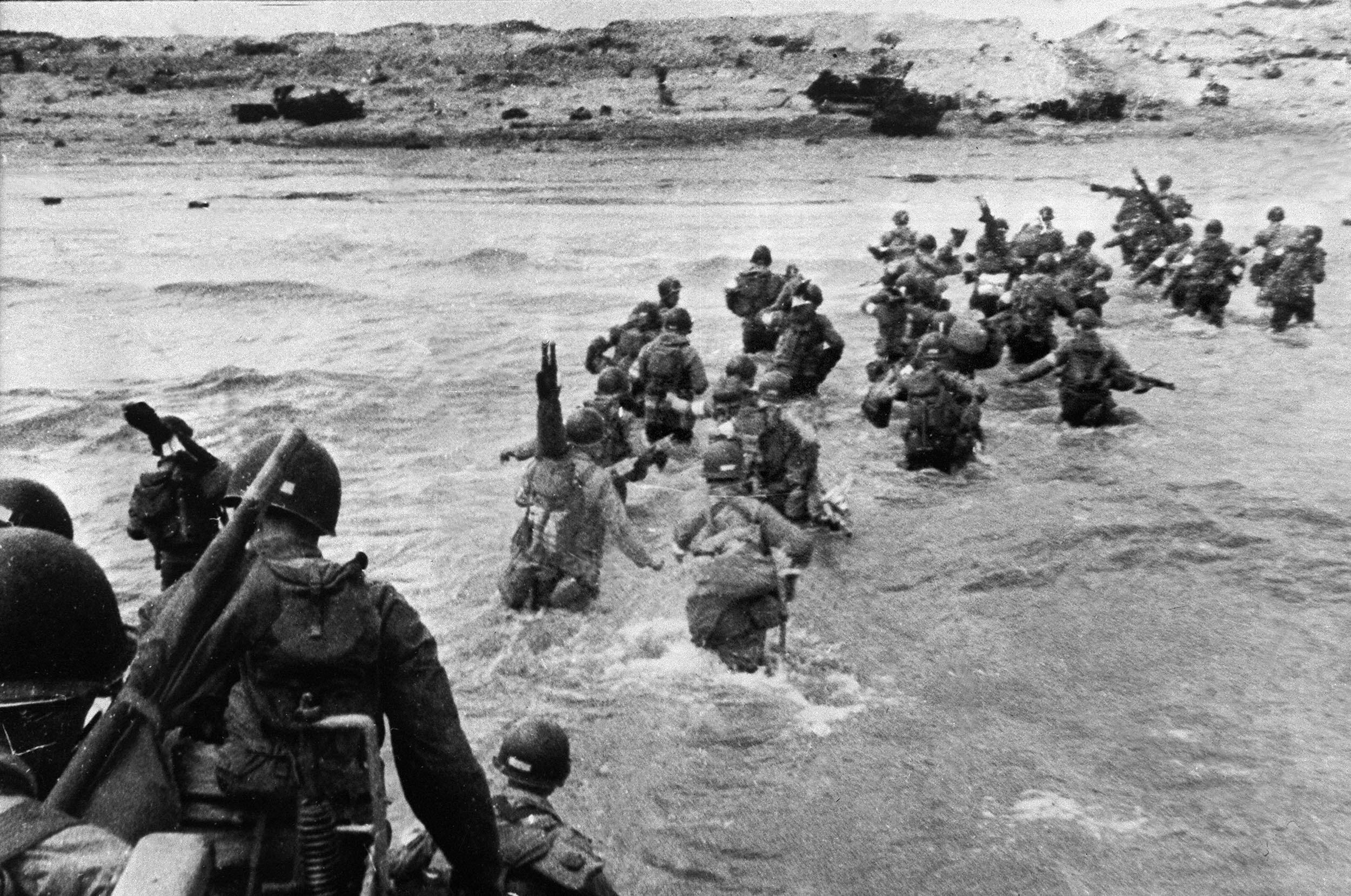 U.S. troops disembark from landing crafts during D-Day June 6, 1944 after Allied forces stormed the Normandy beaches.
