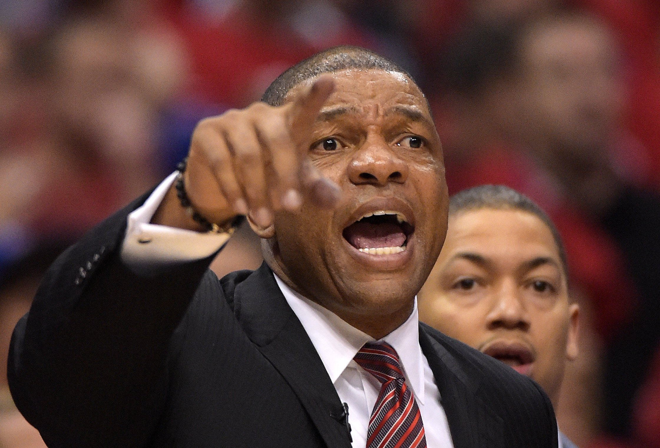 Los Angeles Clippers head coach Doc Rivers yells to his team during the second half of Game 7 in an opening-round NBA basketball playoff series against the Golden State Warriors on May 3, 2014.