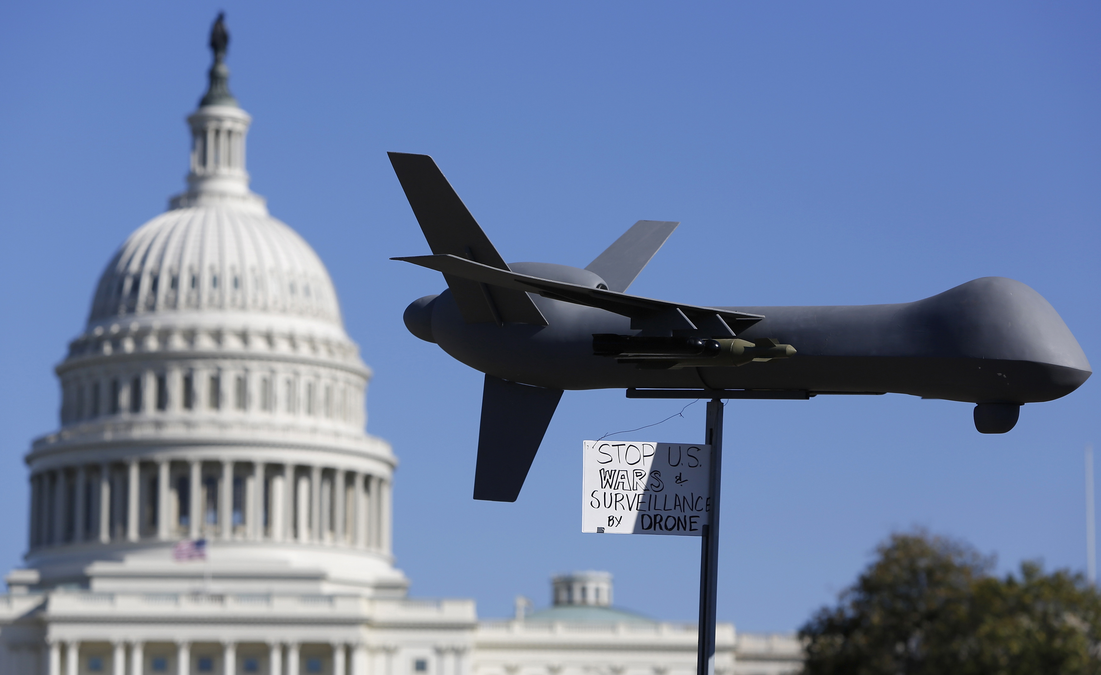Demonstrators deploy a model of a U.S. drone aircraft at the  Stop Watching Us: A Rally Against Mass Surveillance  near the U.S. Capitol in Washington, Oct. 26, 2013