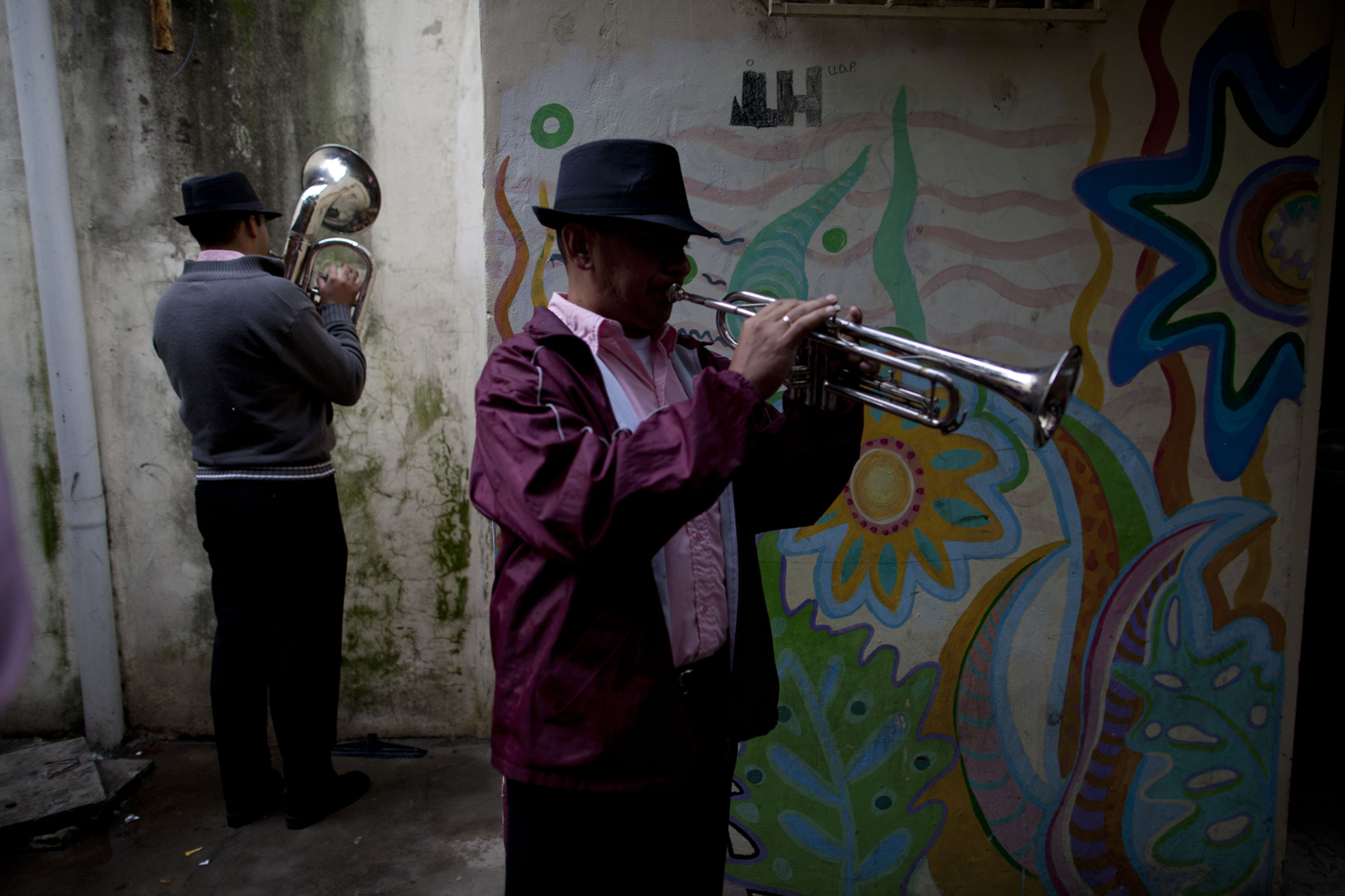 May 11, 2014. Two men rehearse before performing at a procession during the 40th anniversary of the assassination of priest Carlos Mugica at the  31  slum in Buenos Aires, Argentina.