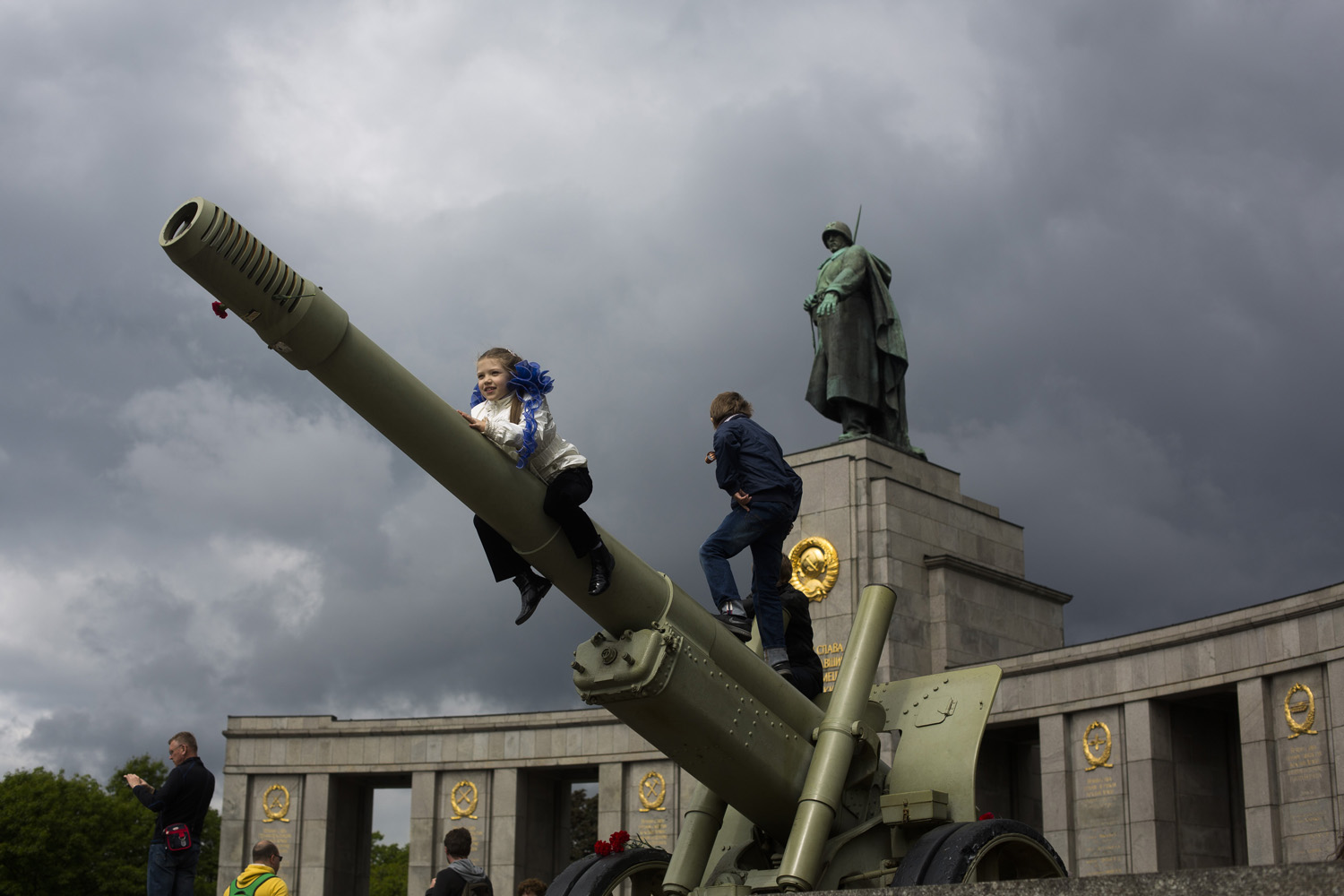 May 9 , 2014. A Russian girl plays with other children on an ordnance during the celebrations of Victory Day at the Soviet war monument and cemetery at the district Tiergarten in Berlin, Germany.