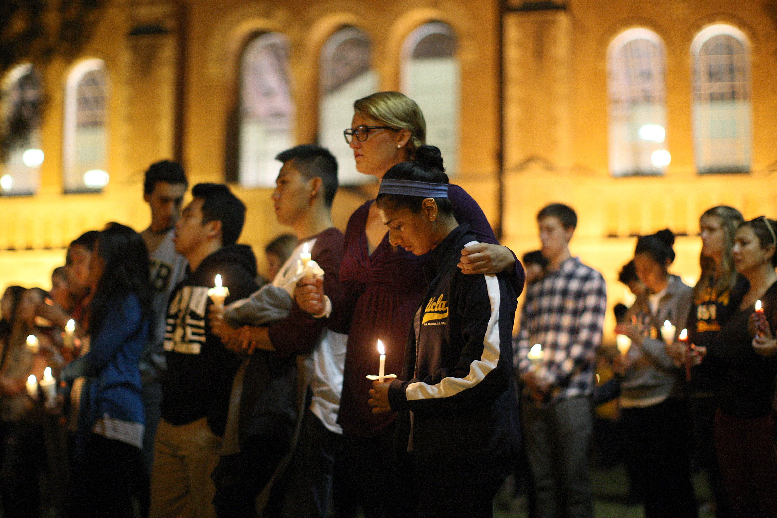 Students of UCSB and UCLA mourn at a candlelight vigil at UCLA for the victims of a killing rampage over the weekend on May 26, 2014 in Los Angeles.