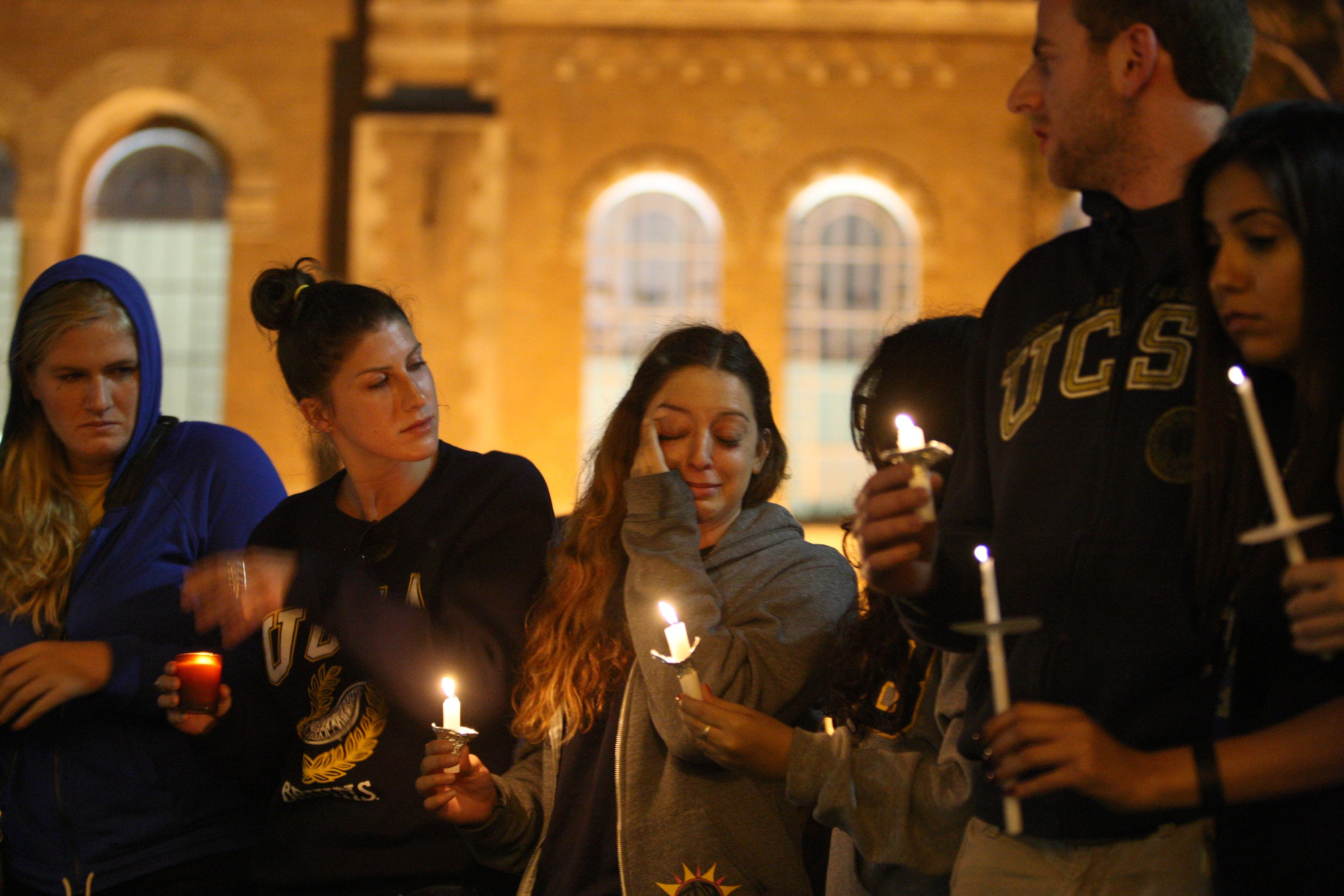 Students of UCSB and UCLA mourn at a candlelight vigil at UCLA for the victims of a killing rampage over the weekend near UCSB on May 26, 2014 in Los Angeles, Calif.