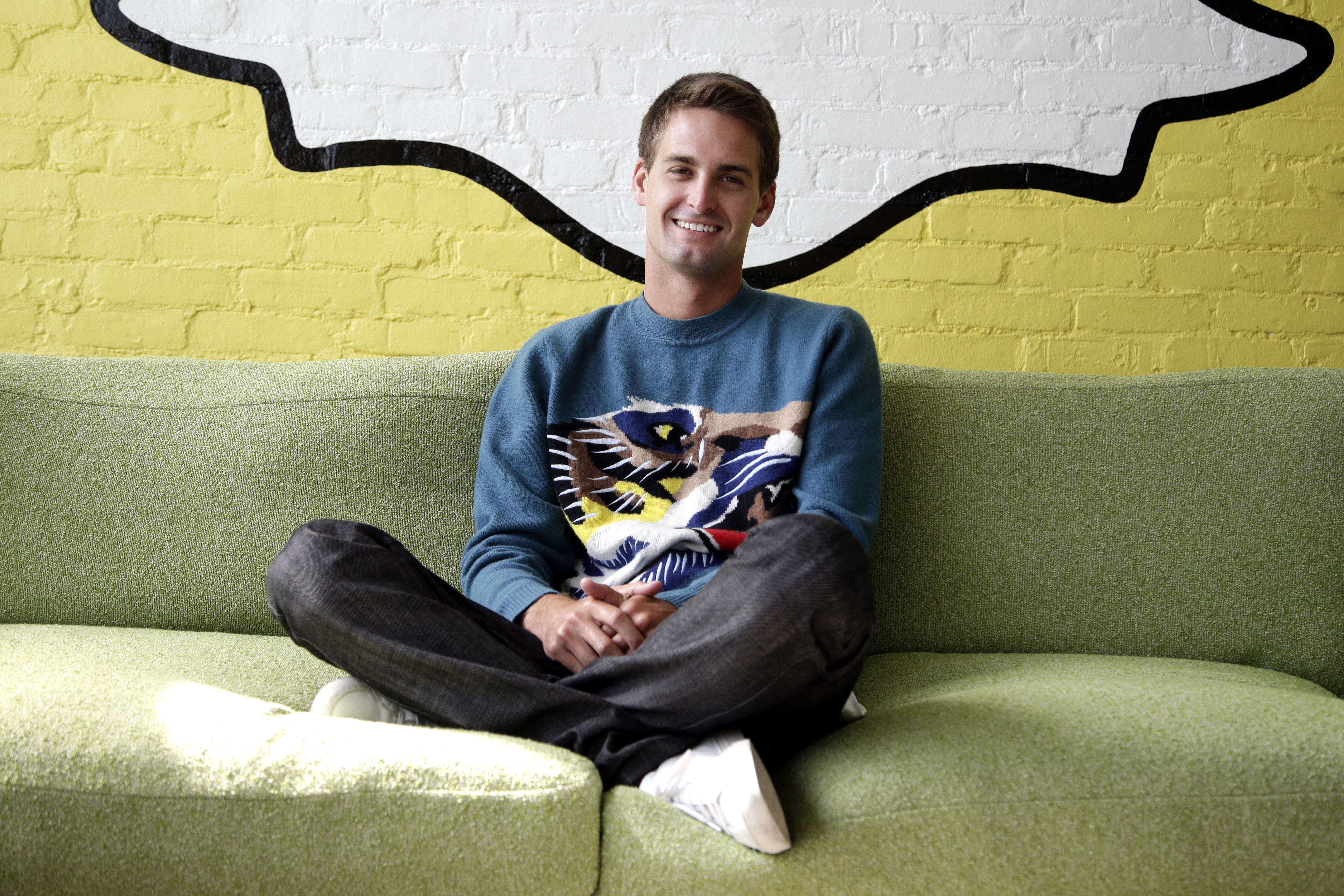 Snapchat CEO Evan Spiegel poses for photos, in Los Angeles, Oct. 24, 2013.