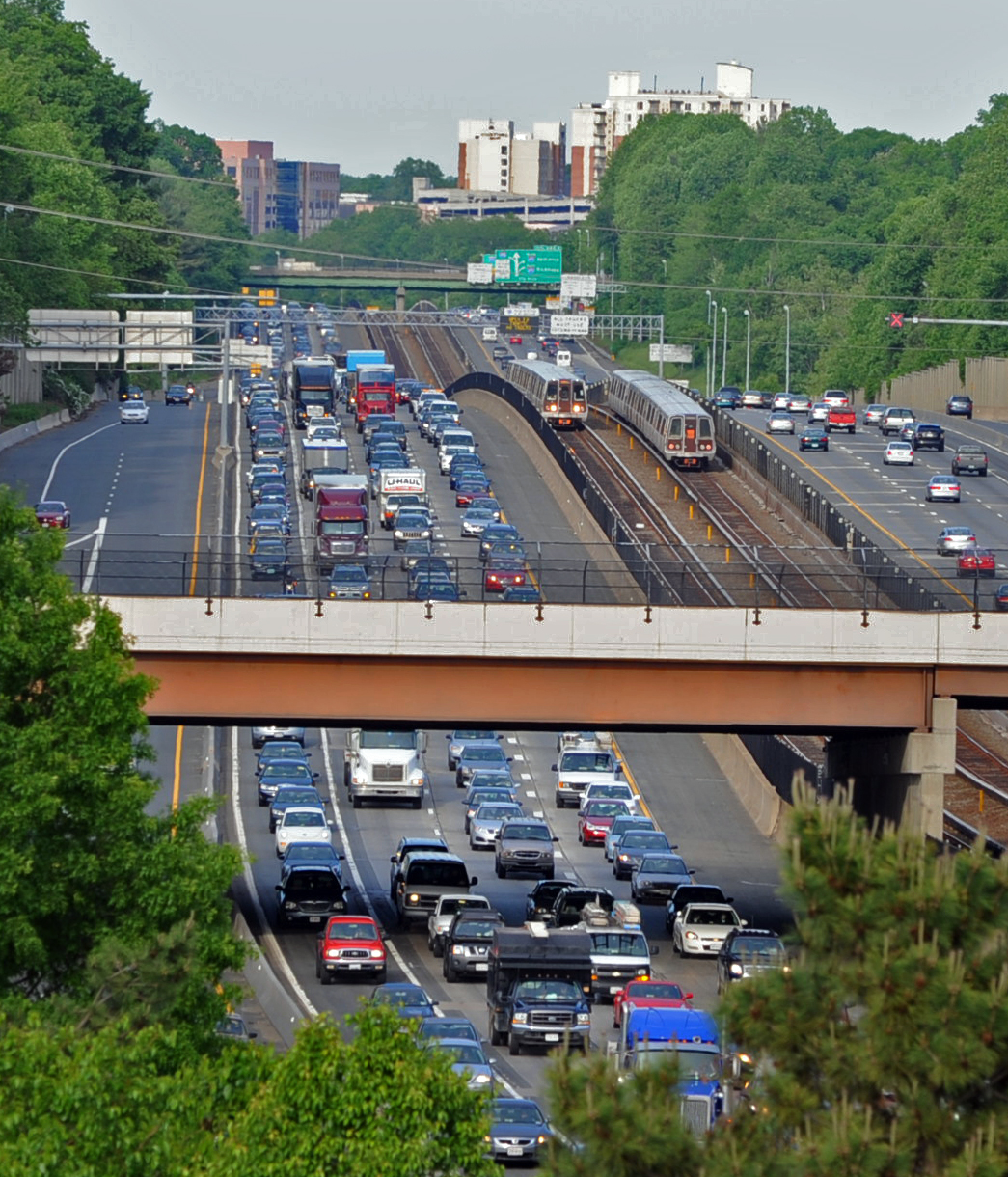 Metro trains move to and from the Vienna Metro Station alongside I-66 traffic in Fairfax, VA. on May 18, 2009.