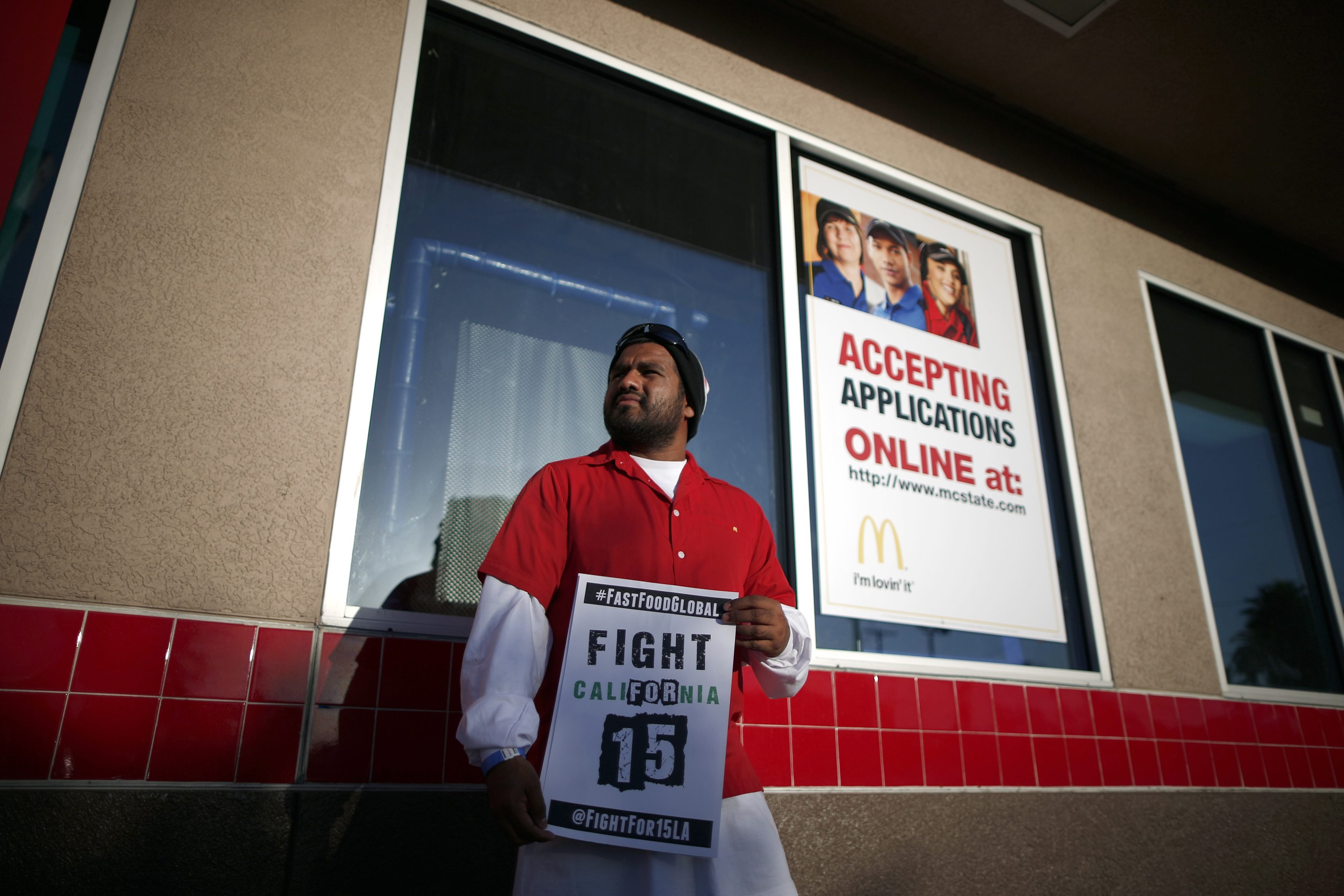 <b>Los Angeles:</b>  Fernando Gutierrez, 26, takes part in a protest to demand higher wages for fast-food workers outside McDonald's on May 15, 2014.