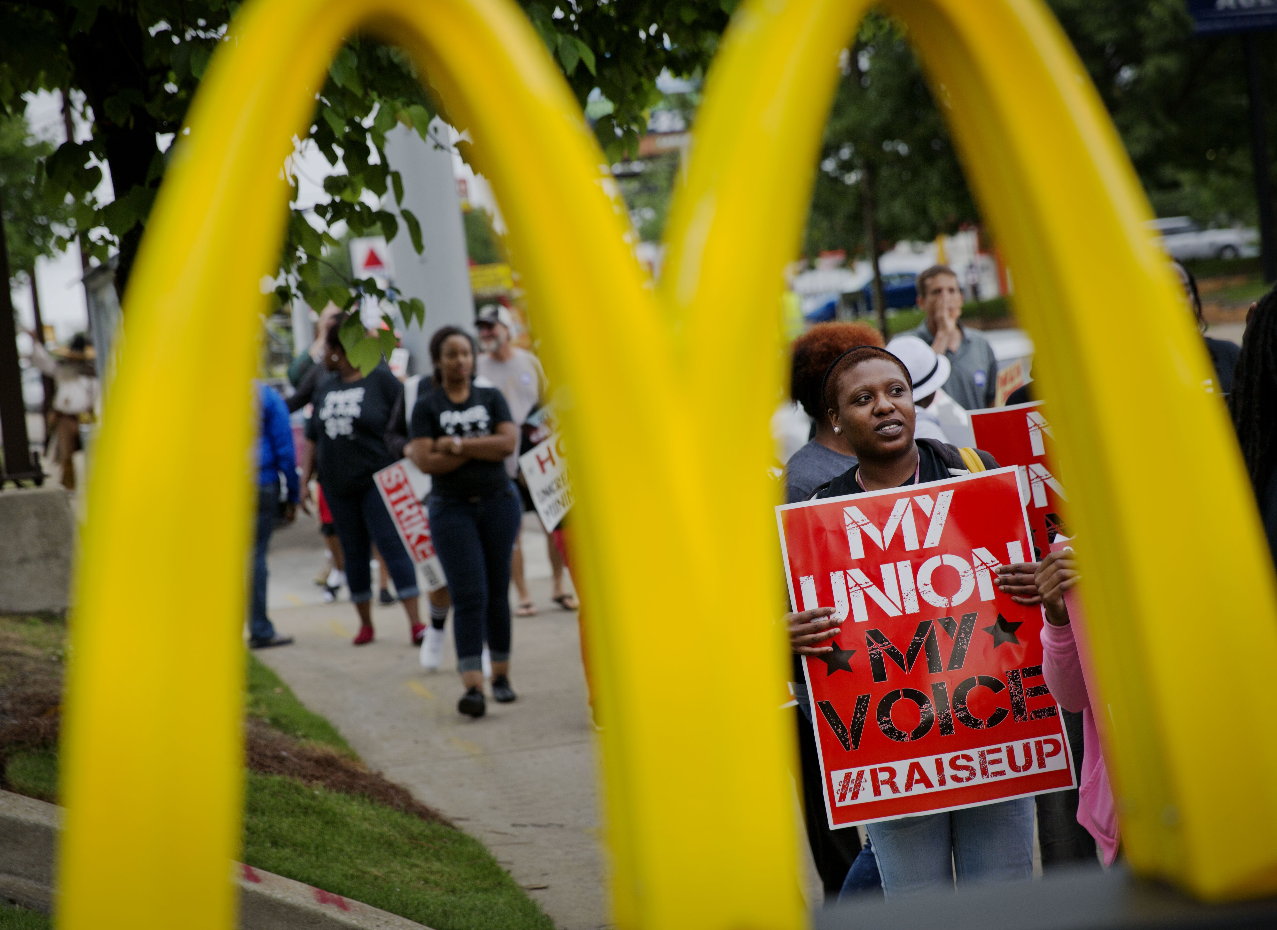<b>Atlanta:</b> Burger King employee Brittany Buckhannon, 24, right, demonstrates during a protest for higher wages and worker's unions outside a McDonald's restaurant on May 15, 2014.