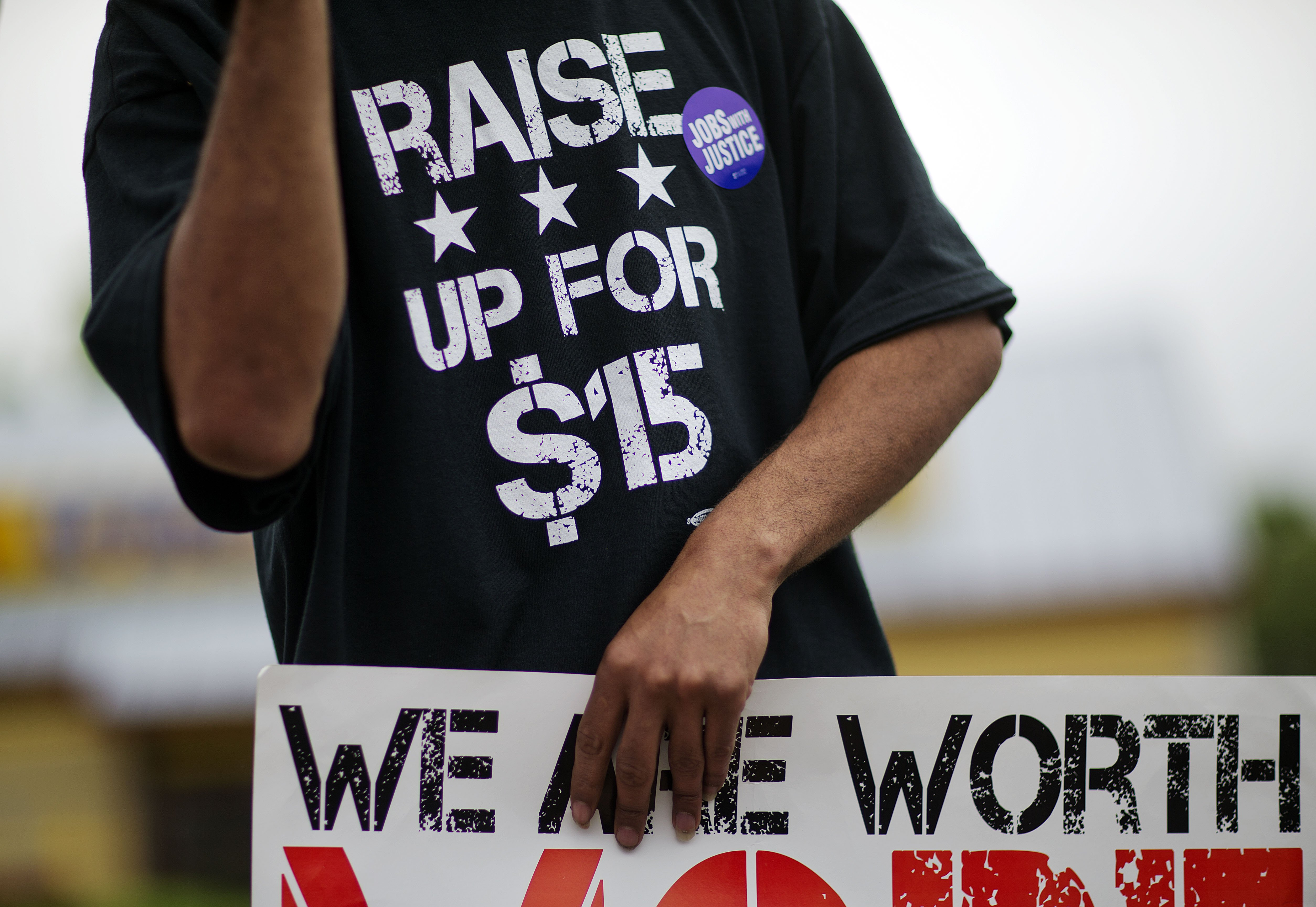 <b>Atlanta:</b> Long John Silver's employee Antwon Brown, 31, wears a shirt advocating for higher wages during a protest outside a Long John Silver's restaurant on May 15, 2014.
