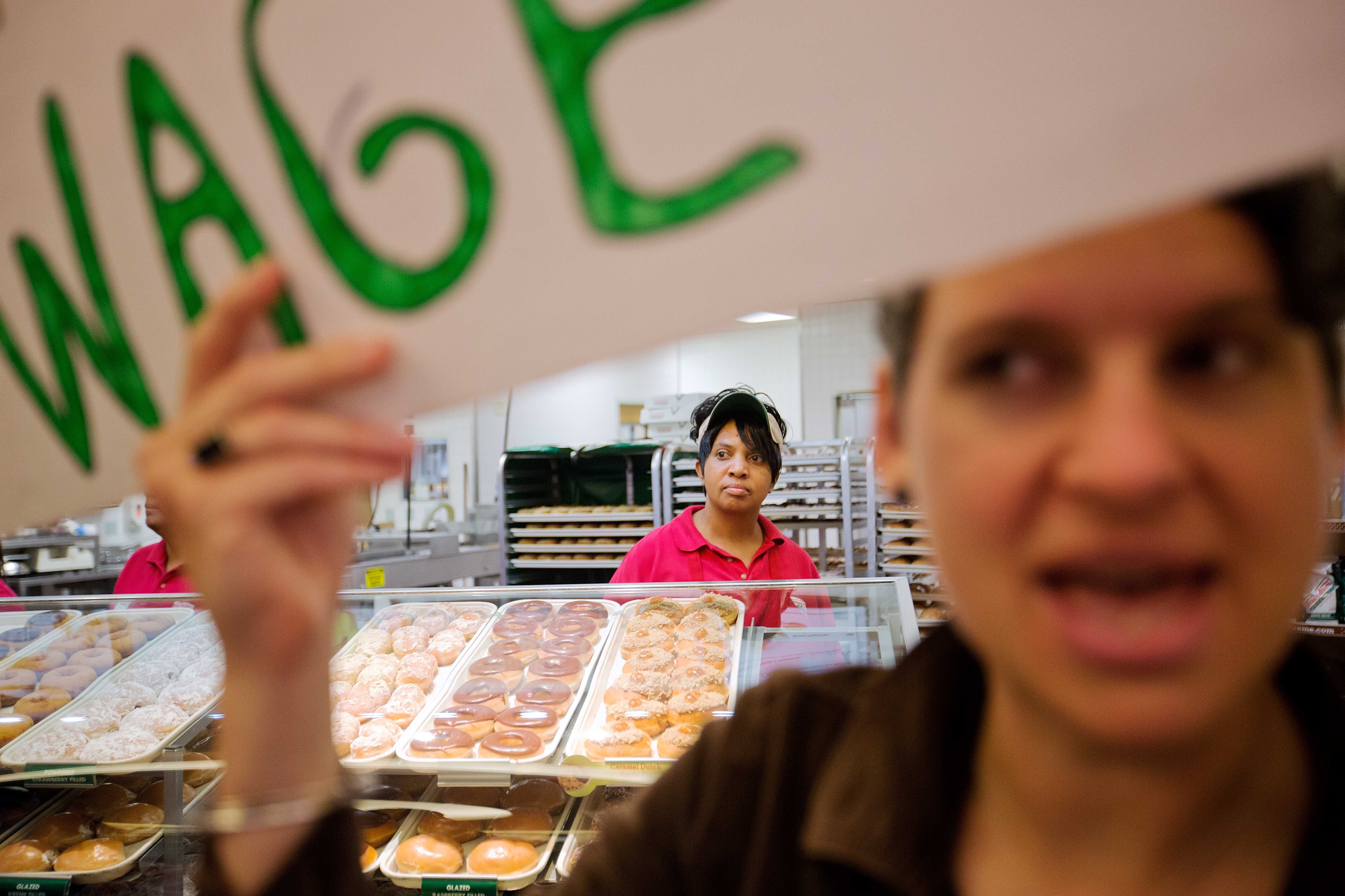 <b>Atlanta:</b> Krispy Kreme employee Beverly Ford, rear, looks on as demonstrators enter the store during a protest on May 15, 2014.