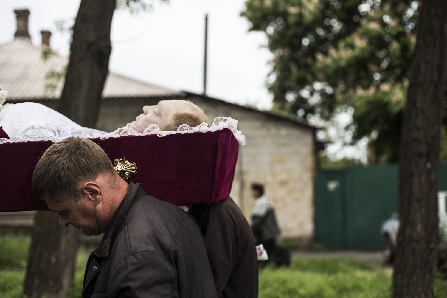 May 12, 2014. Mourners carry the coffin of Alexey Vorobyov, a civilian killed by Ukraine National Guard during an operation against pro Russian activist last Friday in Mariupol, during his funeral in Mariupol, Ukraine.