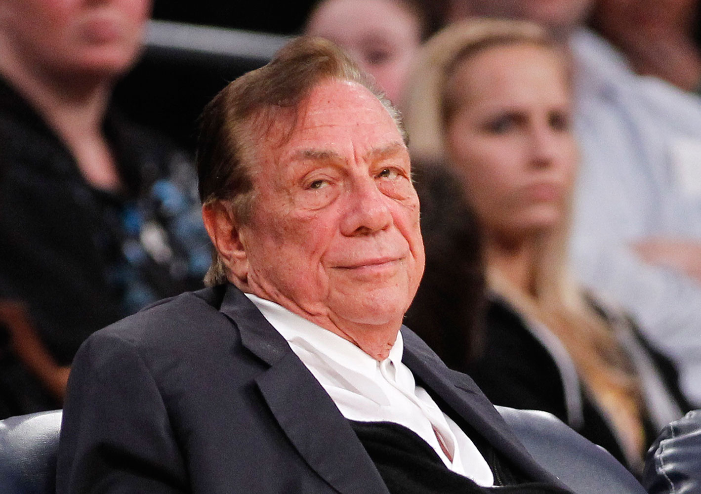 Donald Sterling watches the Clippers play the Los Angeles Lakers during an NBA preseason basketball game in Los Angeles on Dec. 19, 2011