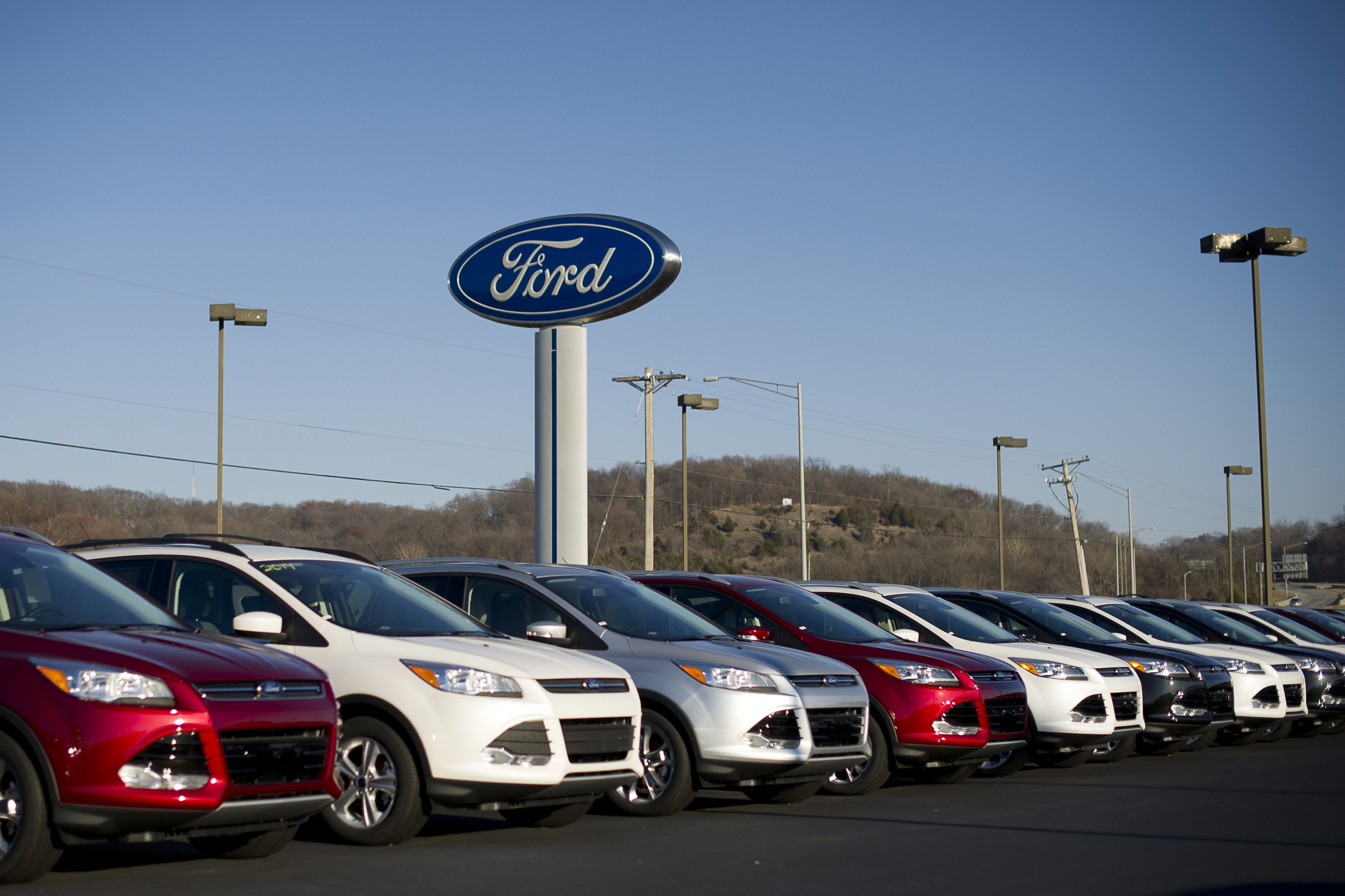 A row of 2014 Ford Escape vehicles sit on display at Uftring Ford in East Peoria, Illinois,  on Nov. 30, 2013.