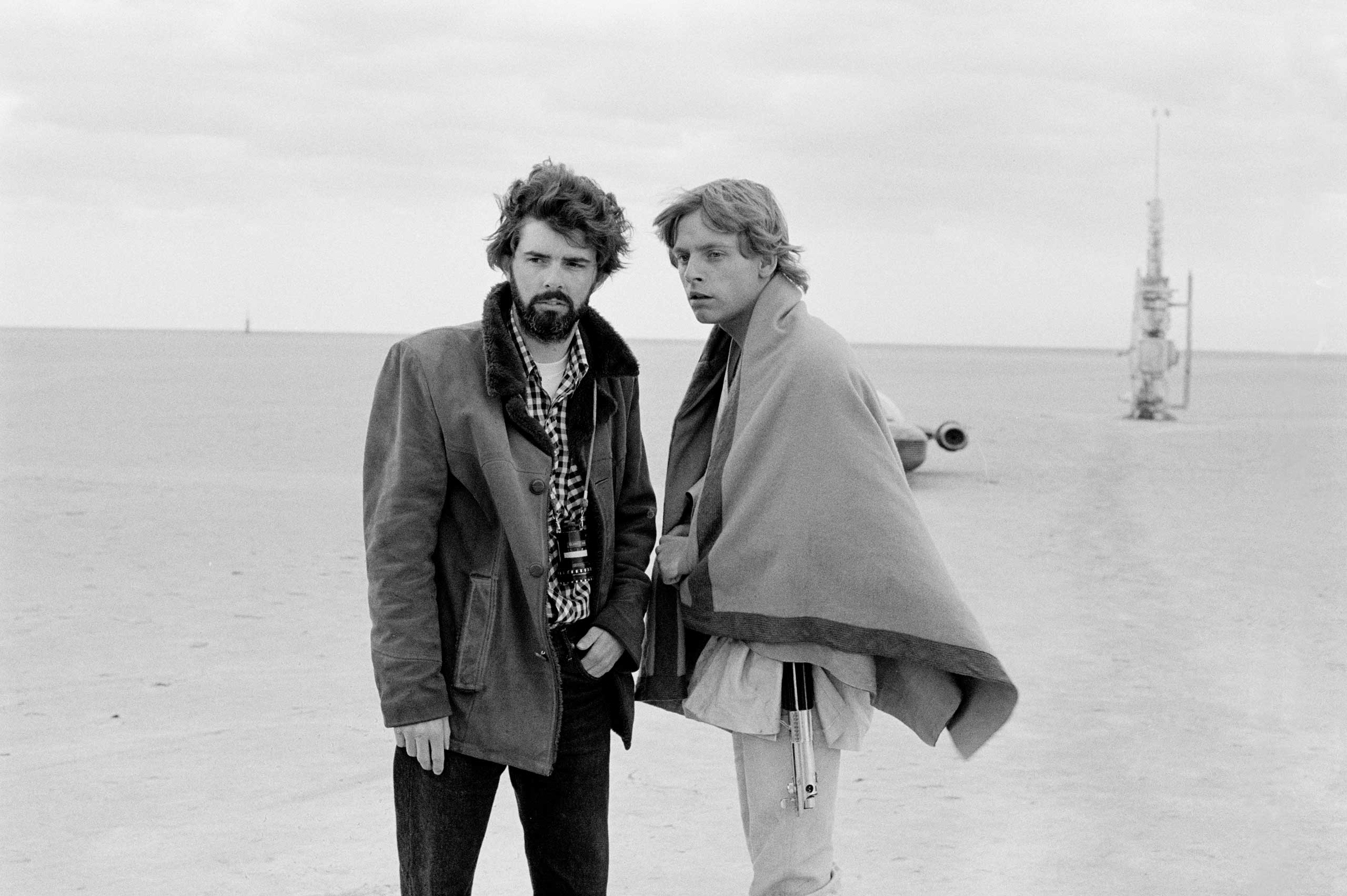 George Lucas and Mark Hamill (Luke Skywalker) on the set of <i>Star Wars: Episode IV - A New Hope</i> in a galaxy far, far away.