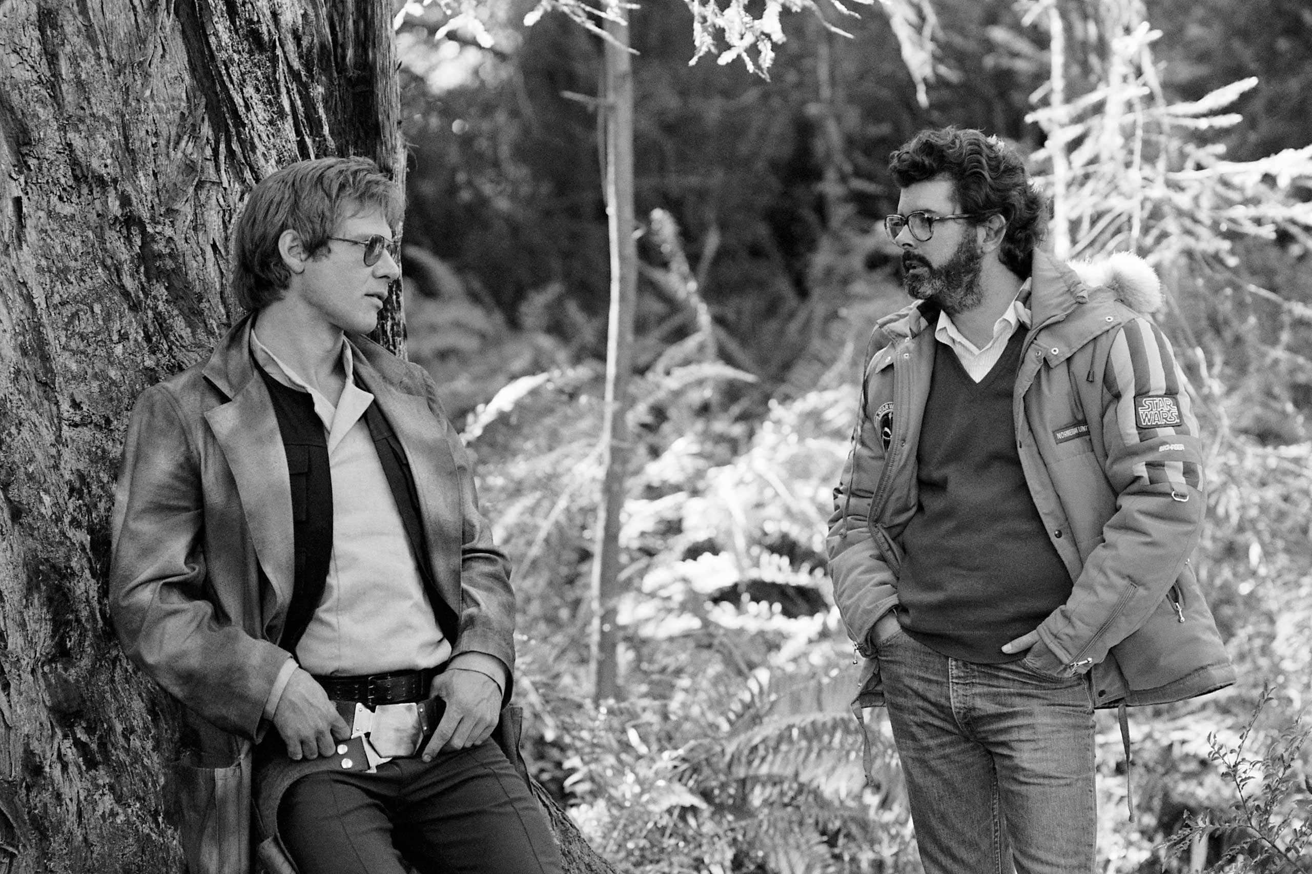 Harrison Ford and Lucas share a moment in Endor on the set of <i>Return of the Jedi</i>.
