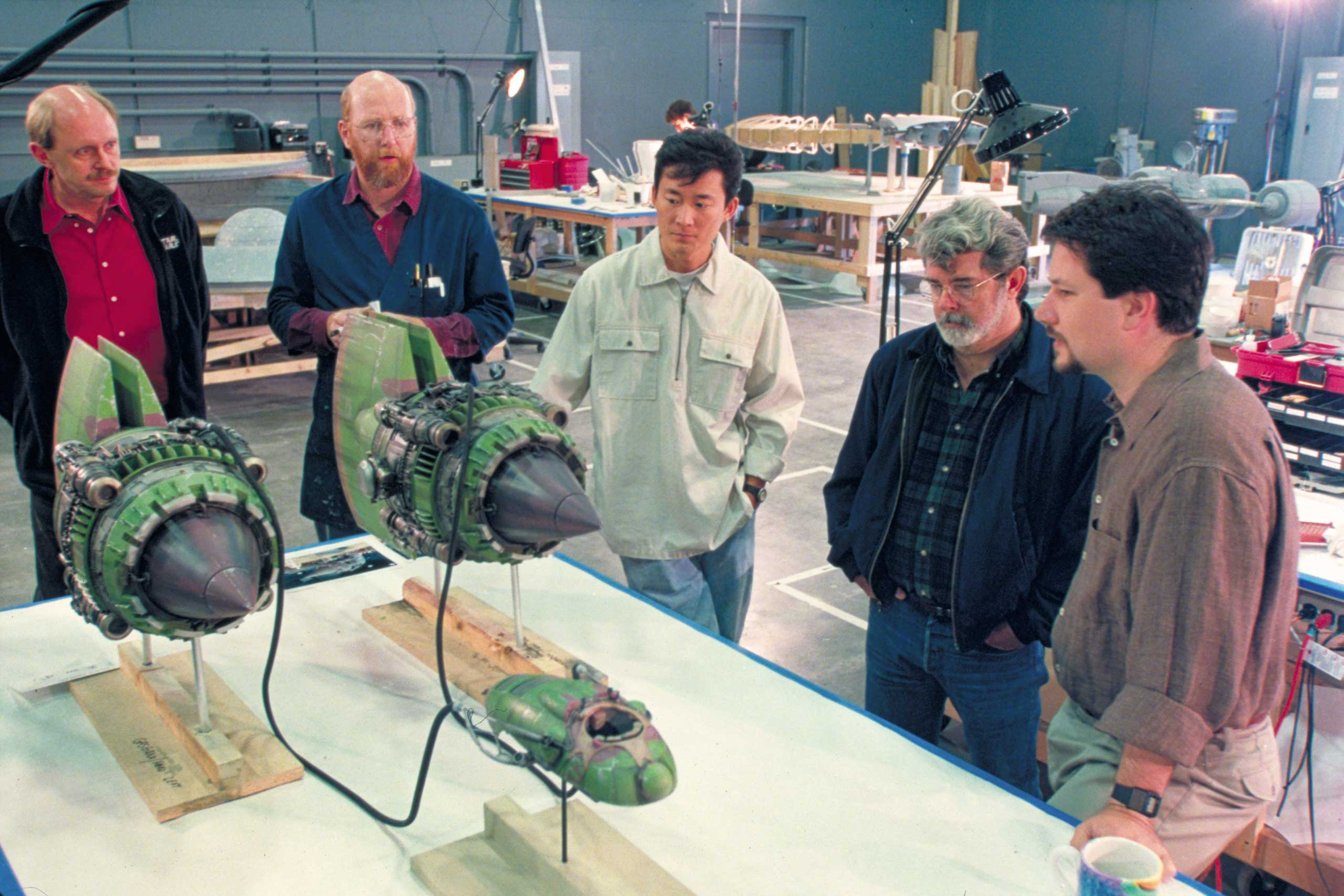 Lucas inspects a model pod racer for <i>Star Wars: Episode I - The Phantom Menace</i>.