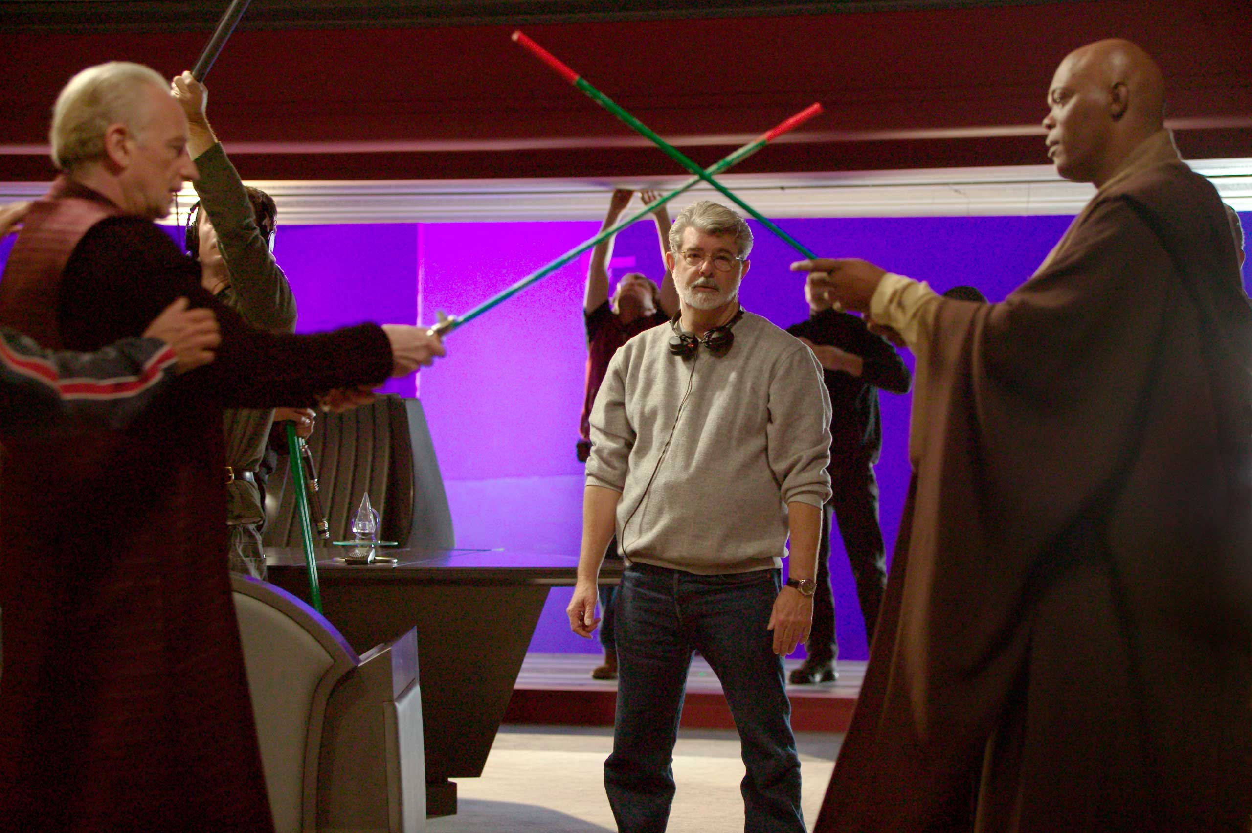 Lucas directs a lightsaber battle between Ian McDiarmid (Chancellor Palpatine/Darth Sidious) and Samuel L. Jackson (Mace Windu) on the set of <i>Star Wars: Episode III - Revenge of the Sith</i>.
