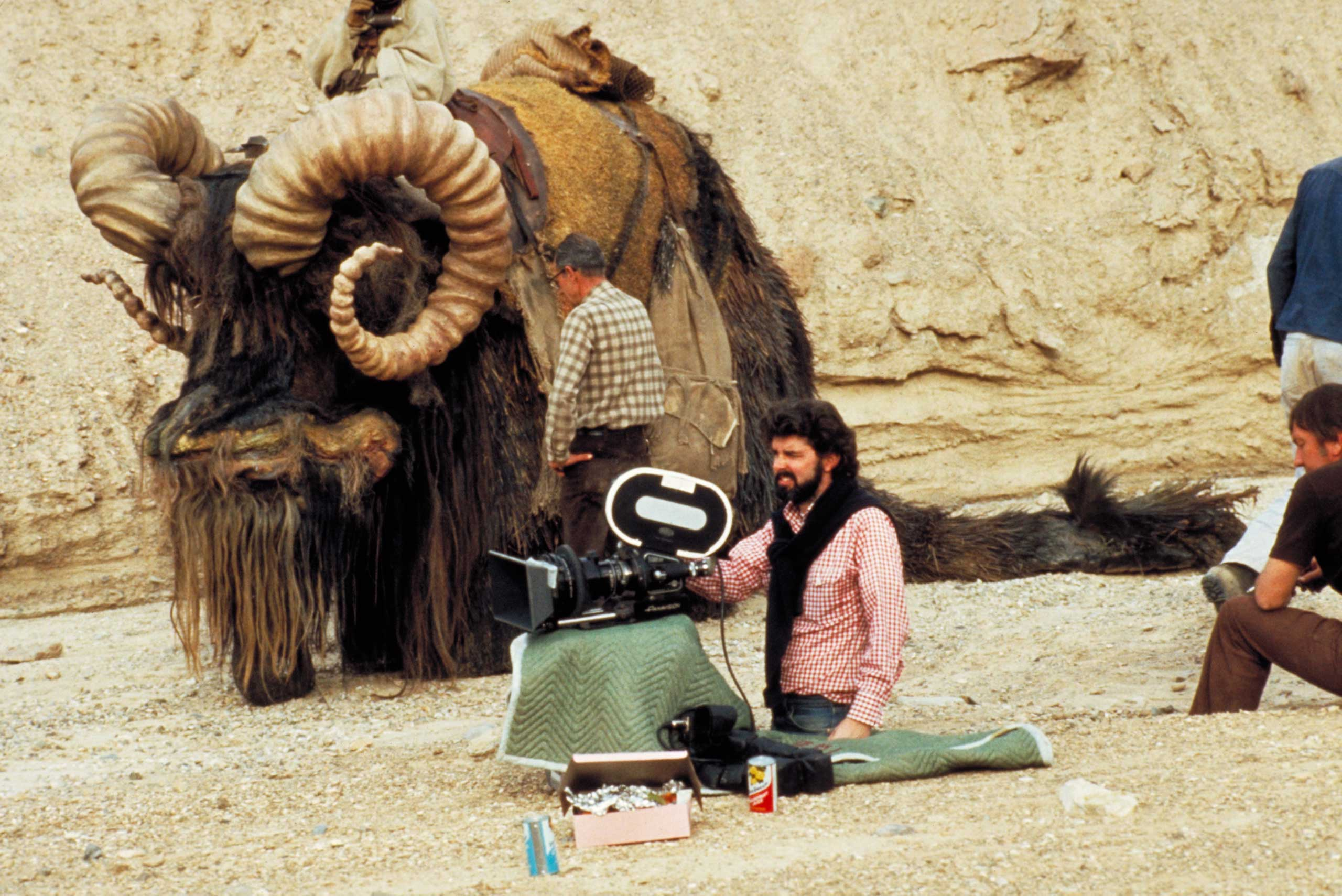 Lucas sets up camp next to a Bantha on the set of Episode IV.