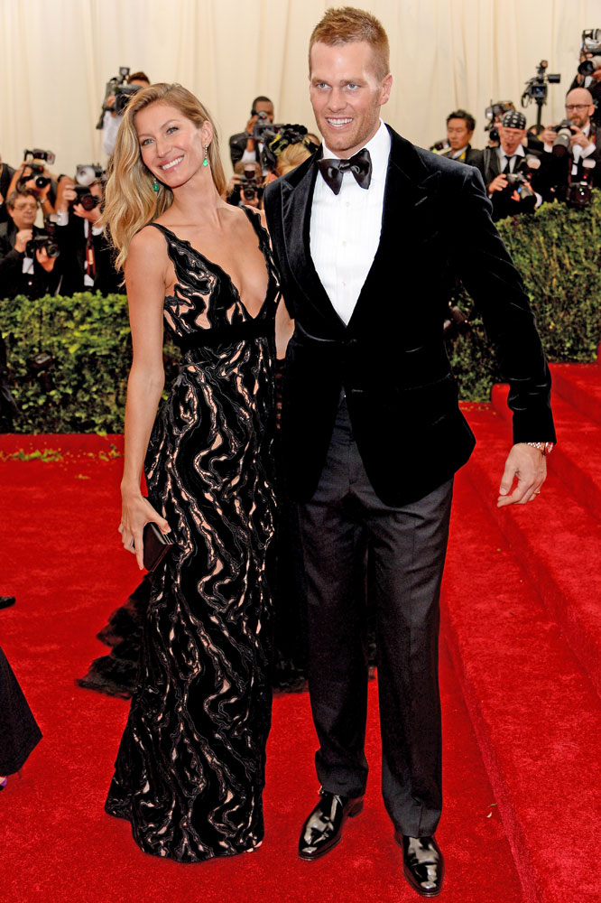 From left: Gisele Bundchen and Tom Brady attend The Metropolitan Museum of Art's Costume Institute benefit gala celebrating  Charles James: Beyond Fashion  on May 5, 2014, in New York City.