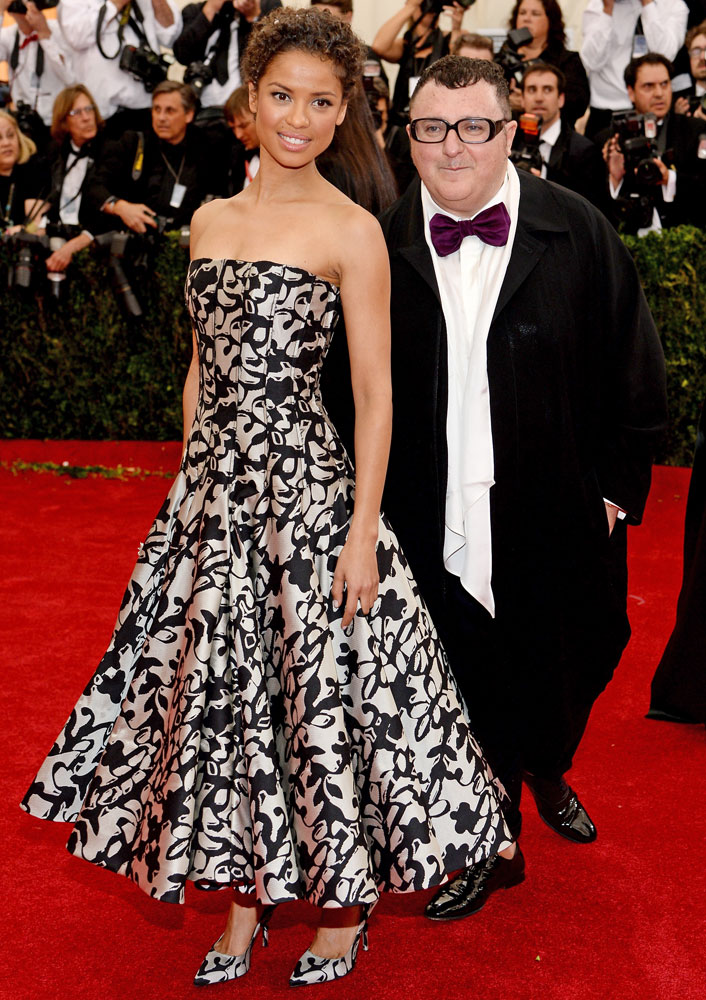 From left: Gugu Mbatha-Raw and Alber Elbaz attend The Metropolitan Museum of Art's Costume Institute benefit gala celebrating  Charles James: Beyond Fashion  on May 5, 2014, in New York City.