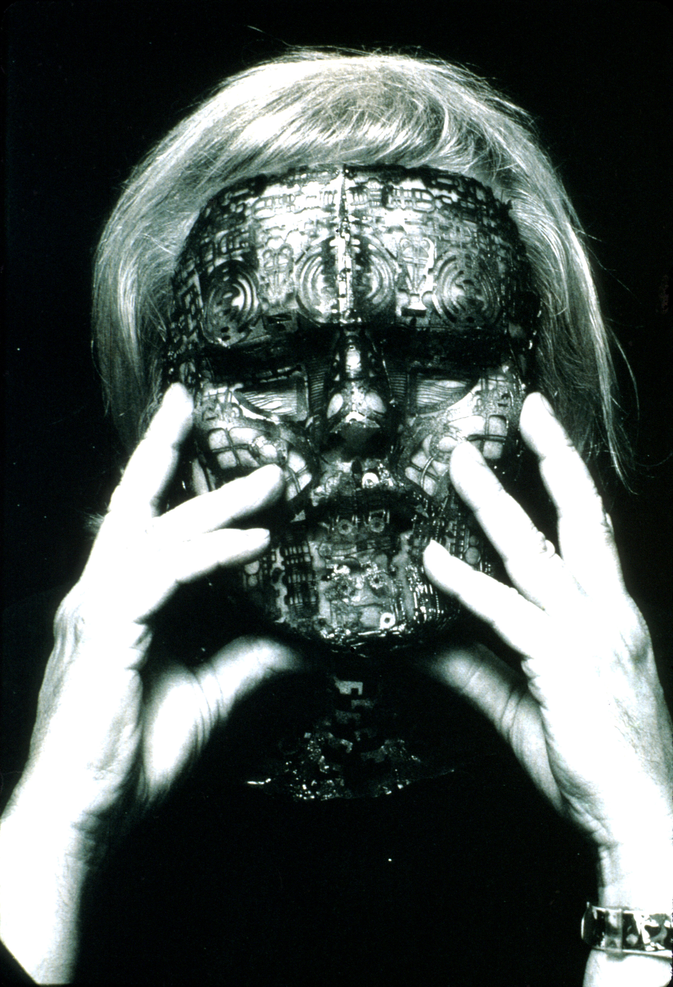 Portrait of artist H. R. Giger with his mask over his face.