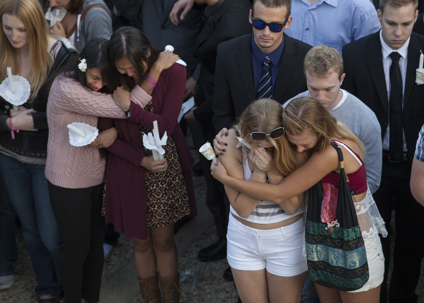 May 24, 2014. Mourners comfort each other during a vigil at the University of California Santa Barbara, where a gunman killed six and injured 13, in Isla Vista, Calif.