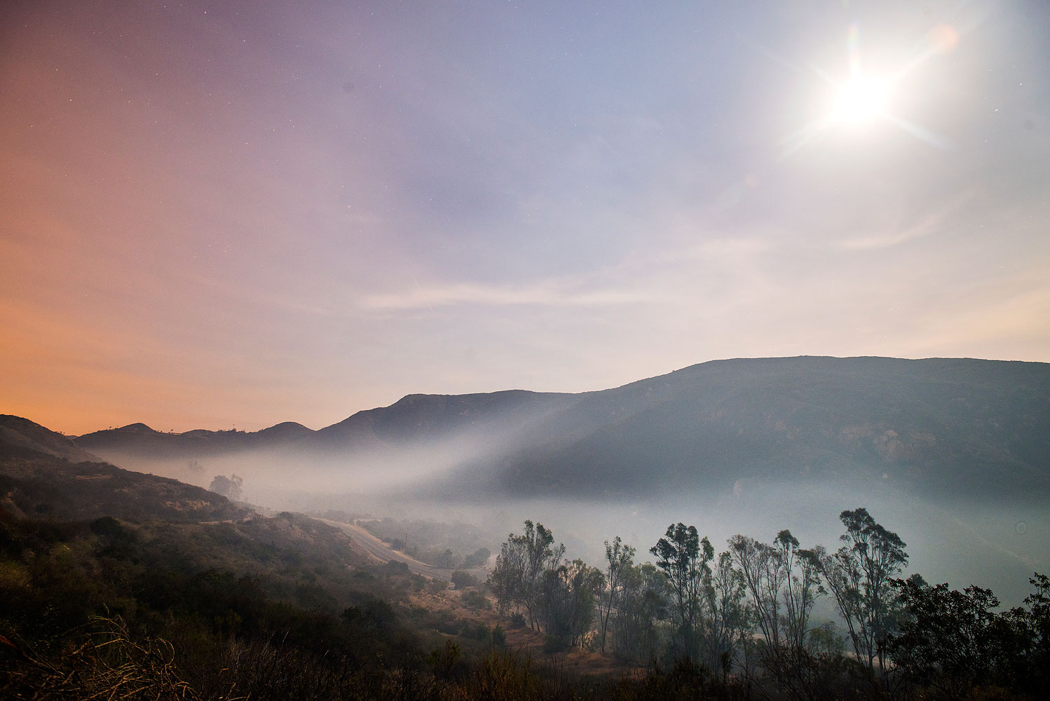 Smoke from the fires in San Marcos and Escondido lays down at dawn due to subsiding winds near Elfin Forest Road, San Diego county, Calif., May 16, 2014.