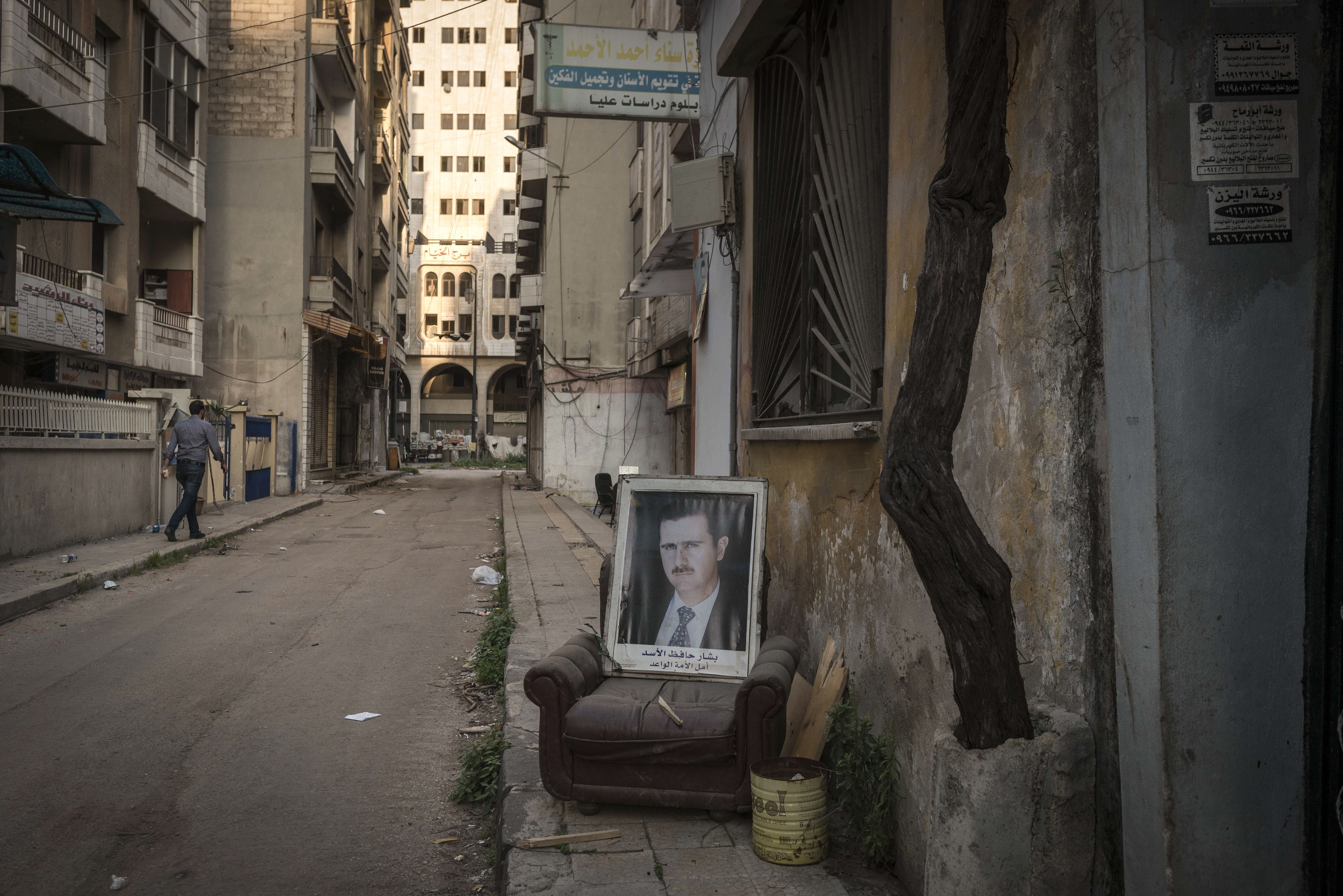 A portrait of President Assad on a street in Homs, Syria, March 23, 2014.