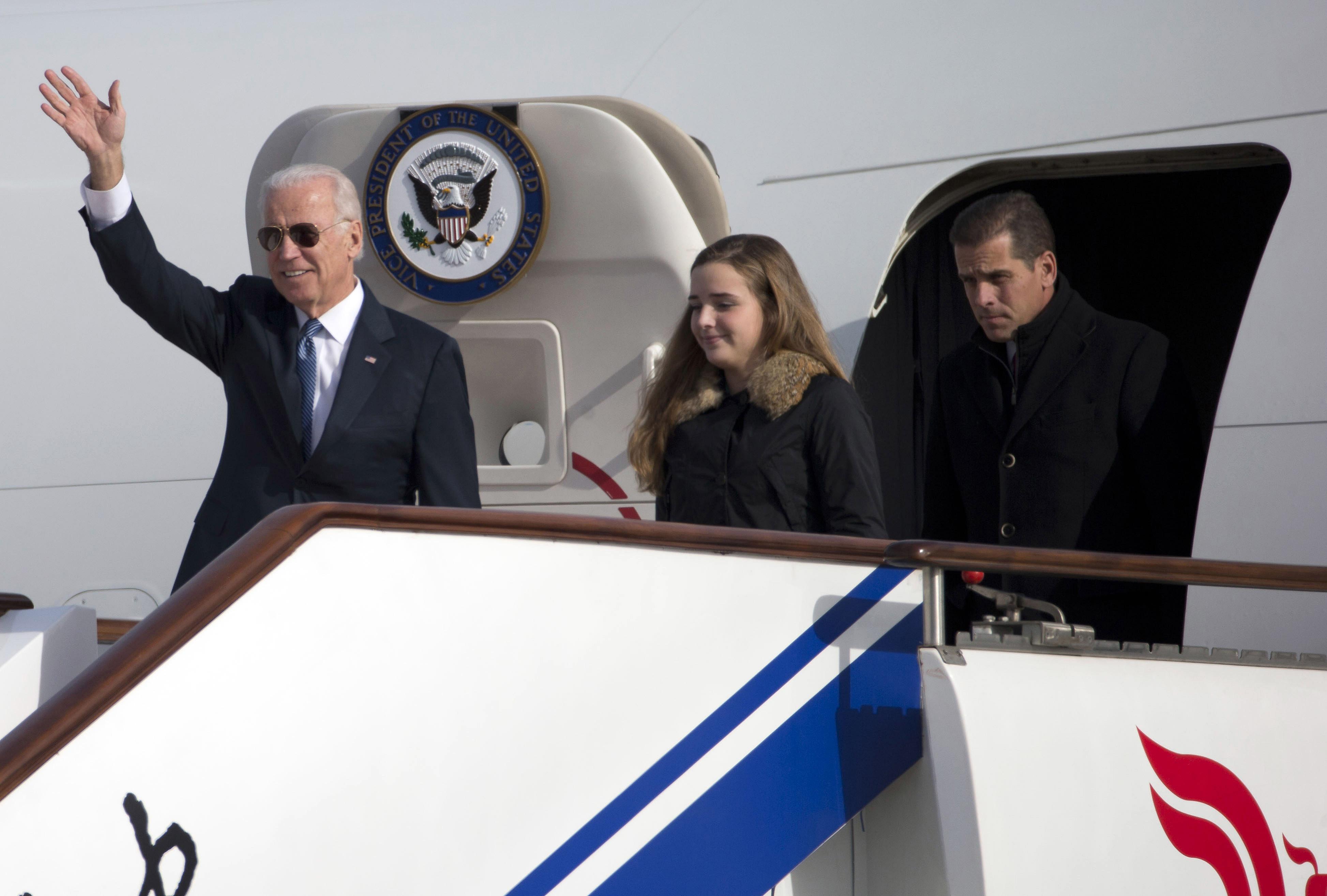 Vice President Joe Biden with his granddaughter Finnegan Biden and son Hunter Biden on Dec. 4, 2013 in Beijing.