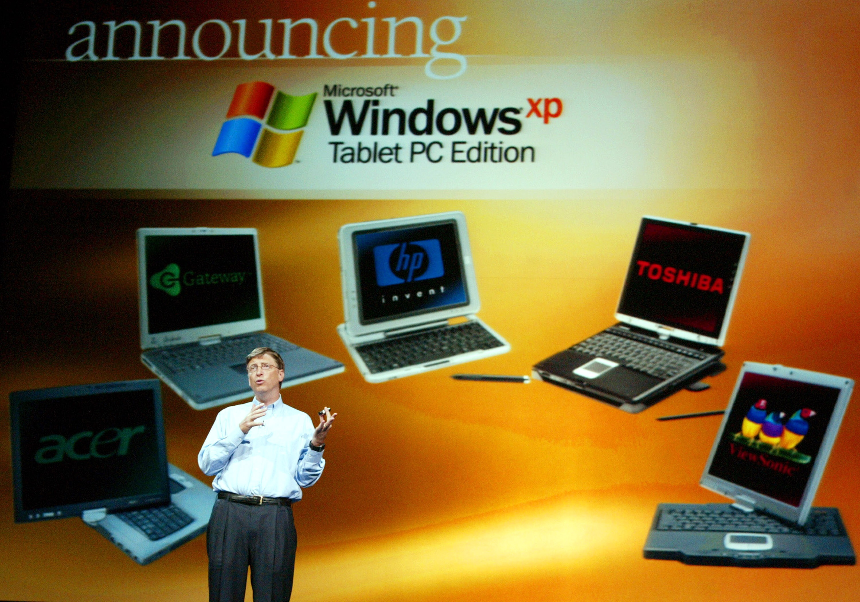 Bill Gates shows off Tablet PCs at COMDEX in Las Vegas on November 16, 2003