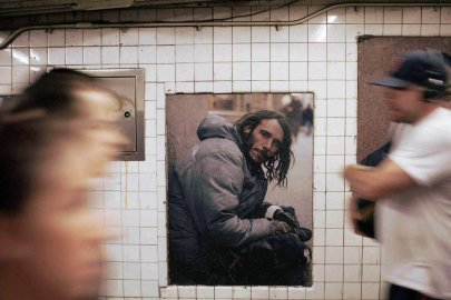 Artist, Andres Serrano's photographic installation, Residents of New York, at the West 4th Street subway  station in New York City.