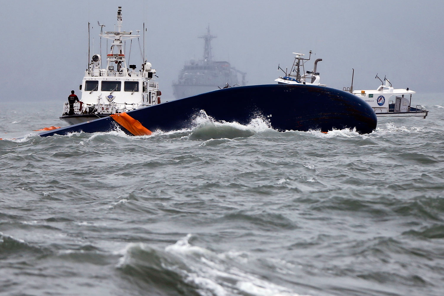 Vessels involved in salvage operations are seen near the upturned Sewol ferry in the sea off the South Korean town of Jindo on April 17, 2014