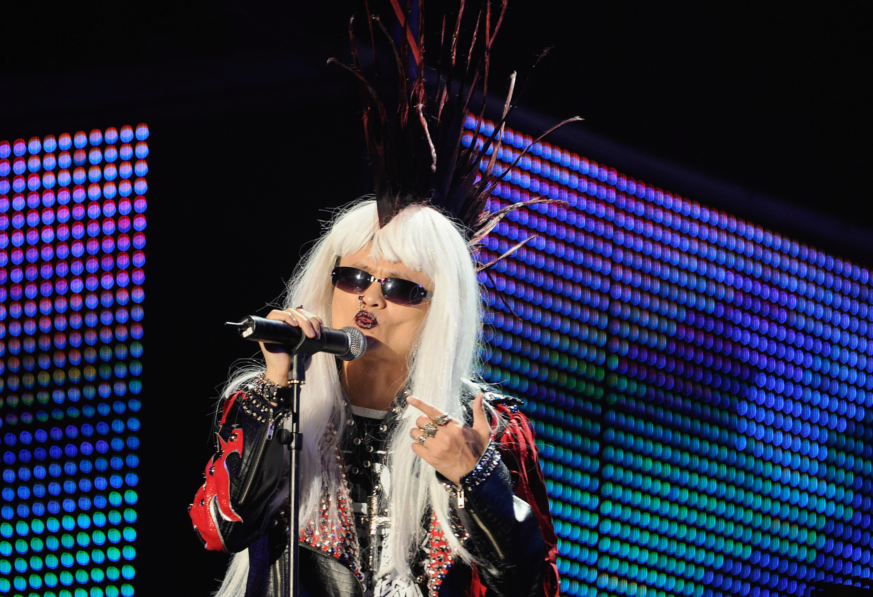 HANGZHOU, CHINA -  Alibaba Group Chairman and Chief Executive Officer Ma Yun dressed as a punk rocker performs during the 10th anniversary celebration of  Alibaba Group founding at Huanglong Sports Center on September 10, 2009 in Hangzhou, Zhejiang Province of China.  (Photo by ChinaFotoPress/Getty Images)