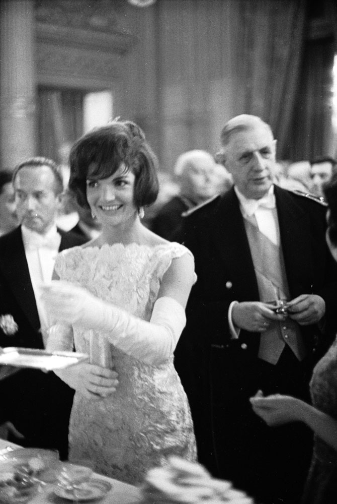 U.S. First Lady Jackie Kennedy attends a luncheon with French President Charles DeGaulle (right) on June 2, 1961 in Washington, D.C.