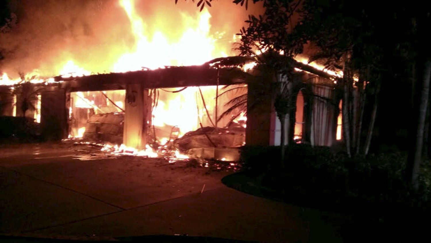 Flames engulf a house owned by former tennis pro James Blake in this photograph provided by the Hillsborough Sheriff's Office in Tampa, Fla. on May 7, 2014.