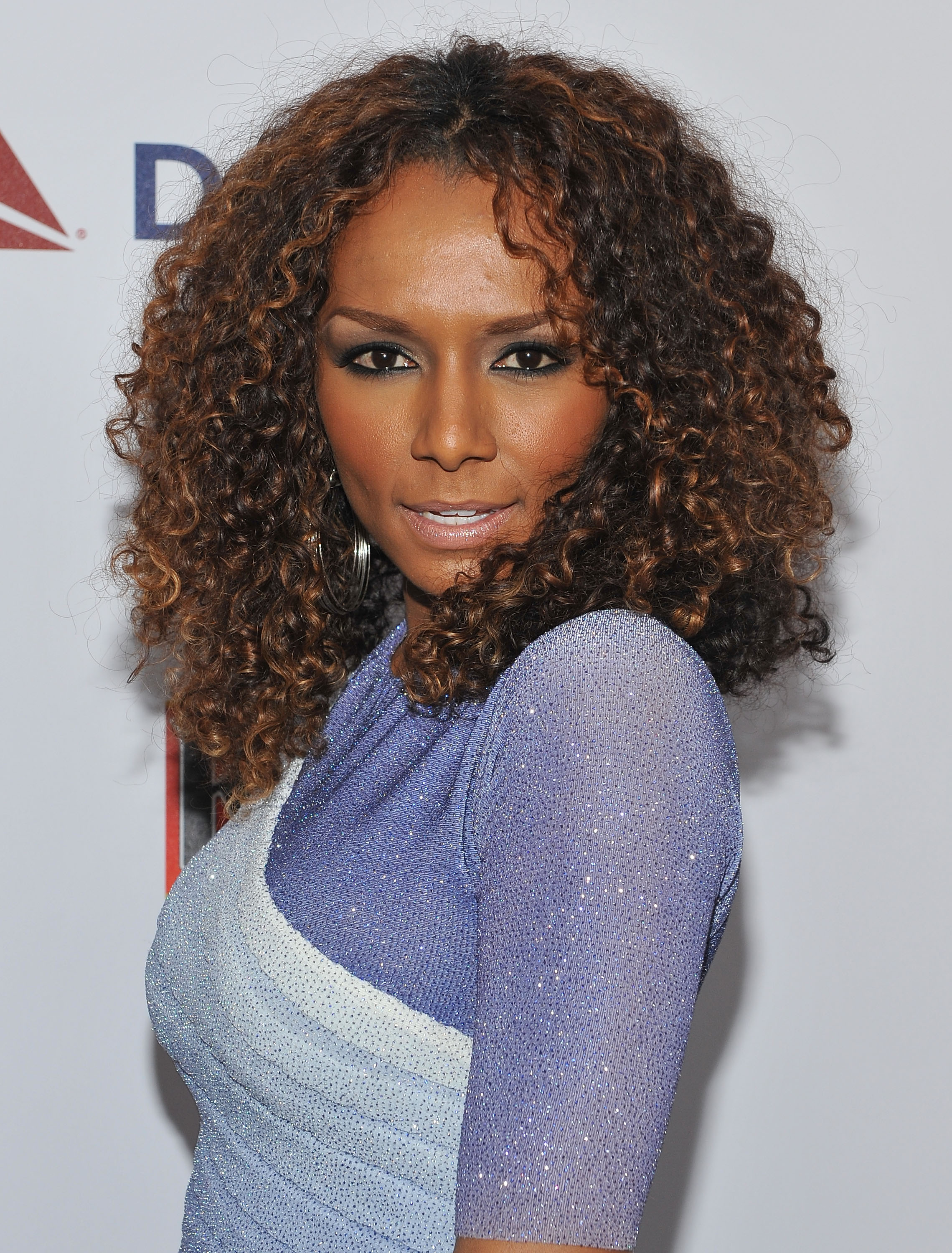 Janet Mock, a transgender advocate and writer, published a best-selling memoir about her transition, <i>Redefining Realness</i>, in 2014 and hosts a MSNBC web talk show about pop culture.
